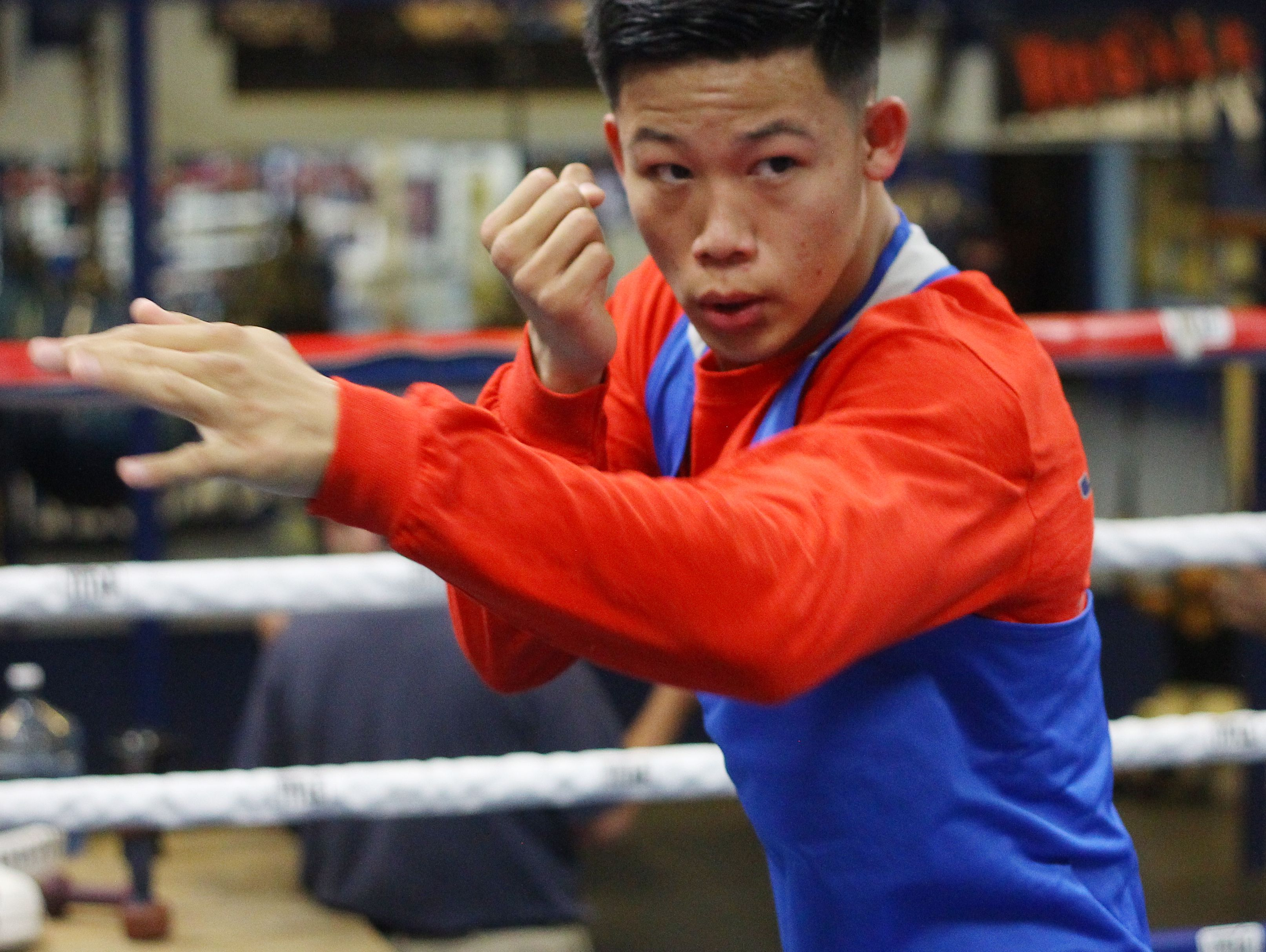 Brandon Lee warms up for a sparring session at the Coachella Boxing Club as he prepares to debut as a professional boxer this December.