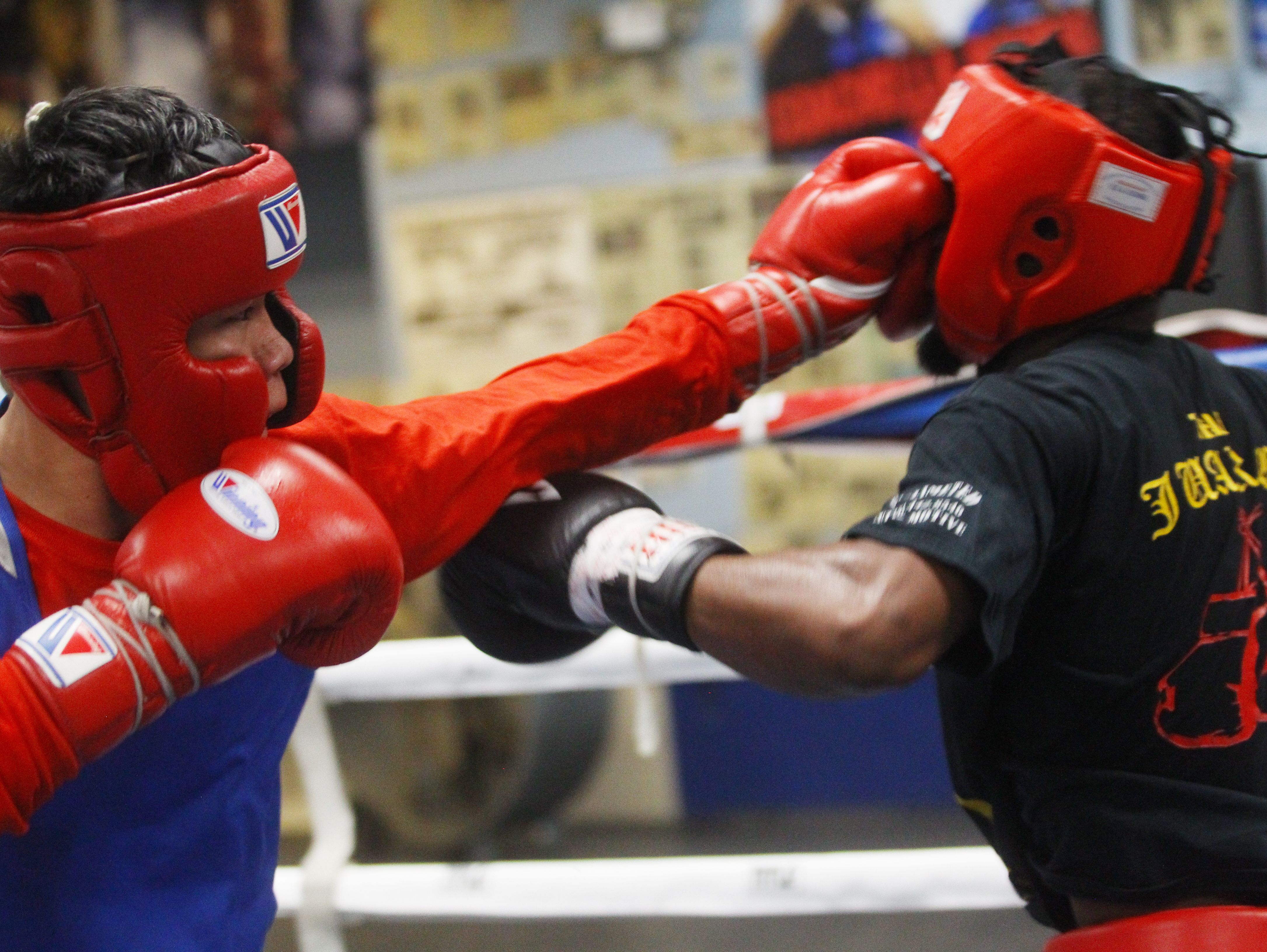 At left, Brandon Lee spars with Kenny Williams at the Coachella Boxing Club as he prepares to debut as a professional boxer this December.