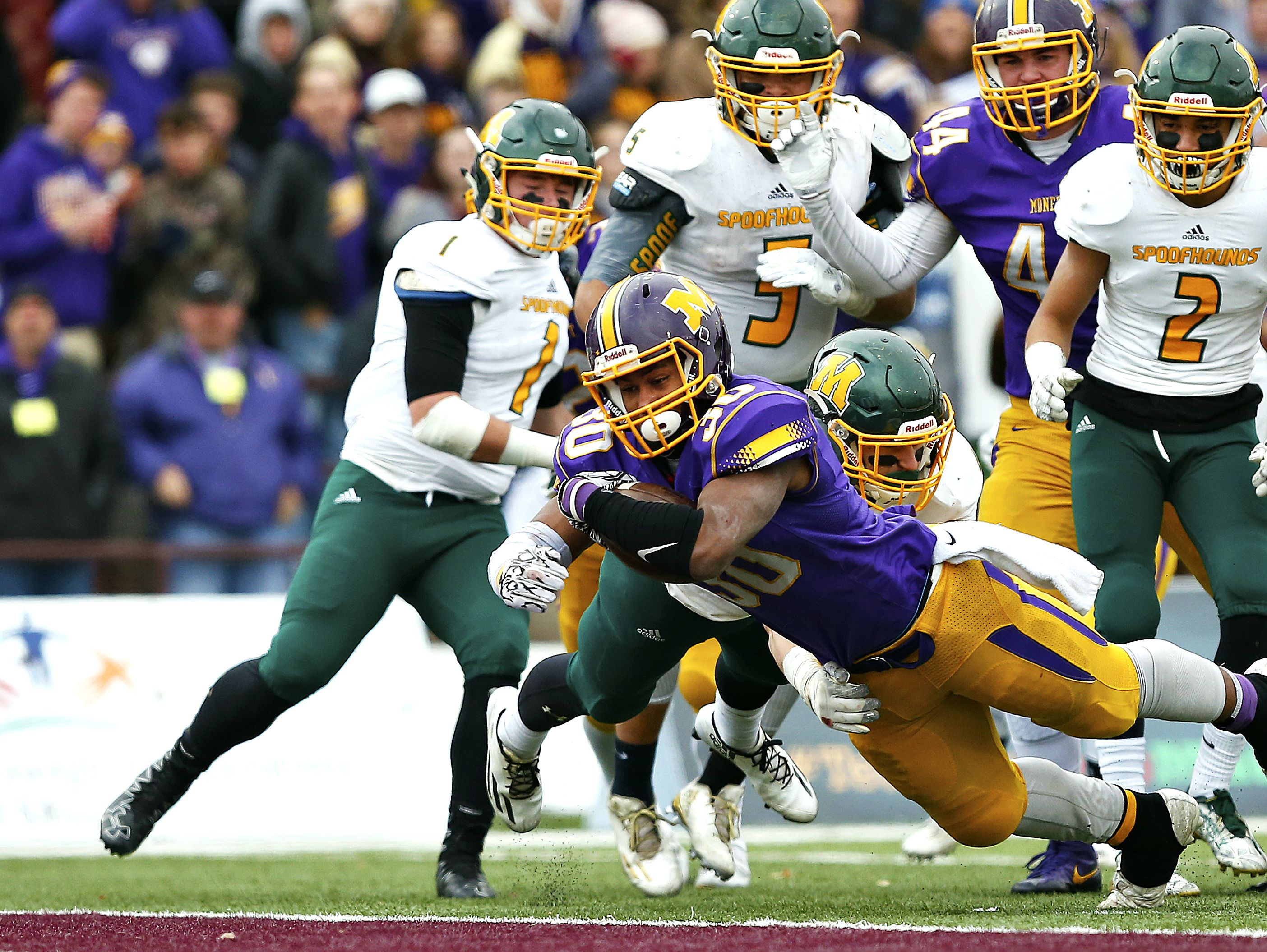 Monett High School running back Michael Branch (30) dives toward the end zone to score a touchdown during third quarter action of the MSHSAA Class 3 State Championship Game between the Monett High School Cubs and the Maryville High School Spoofhounds at Robert W. Plaster Stadium in Springfield, Mo. on Nov. 26, 2016. The Monett Cubs won the game 27-18.