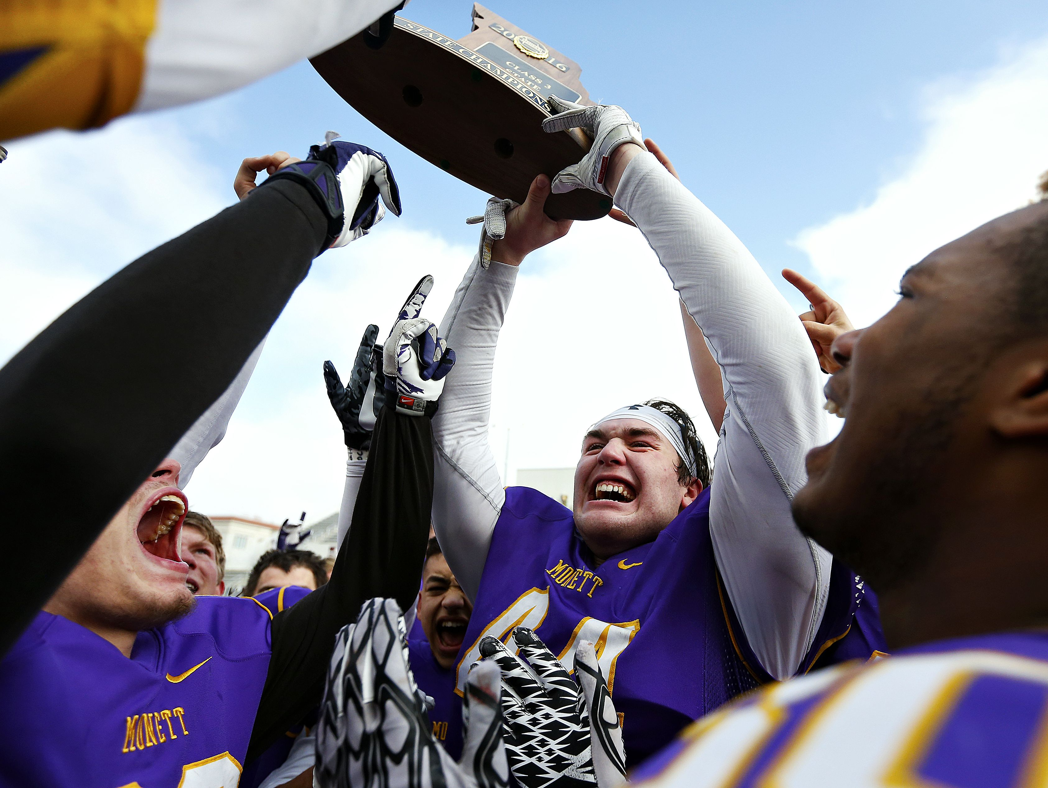 Monett High School tight end David Turner (44)and his teammates celebrate after emerging victorious from the MSHSAA Class 3 State Championship Game between the Monett High School Cubs and the Maryville High School Spoofhounds at Robert W. Plaster Stadium in Springfield, Mo. on Nov. 26, 2016. The Monett Cubs won the game 27-18.