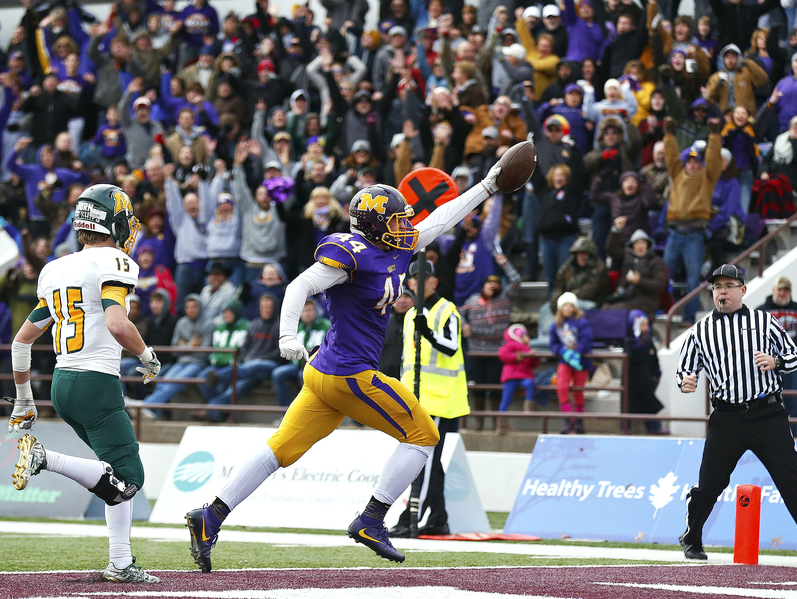 ]Monett High School tight end David Turner (44) celebrates after scoring a receiving touchdown during fourth quarter action of the MSHSAA Class 3 State Championship Game between the Monett High School Cubs and the Maryville High School Spoofhounds at Robert W. Plaster Stadium in Springfield, Mo. on Nov. 26, 2016. The Monett Cubs won the game 27-18.