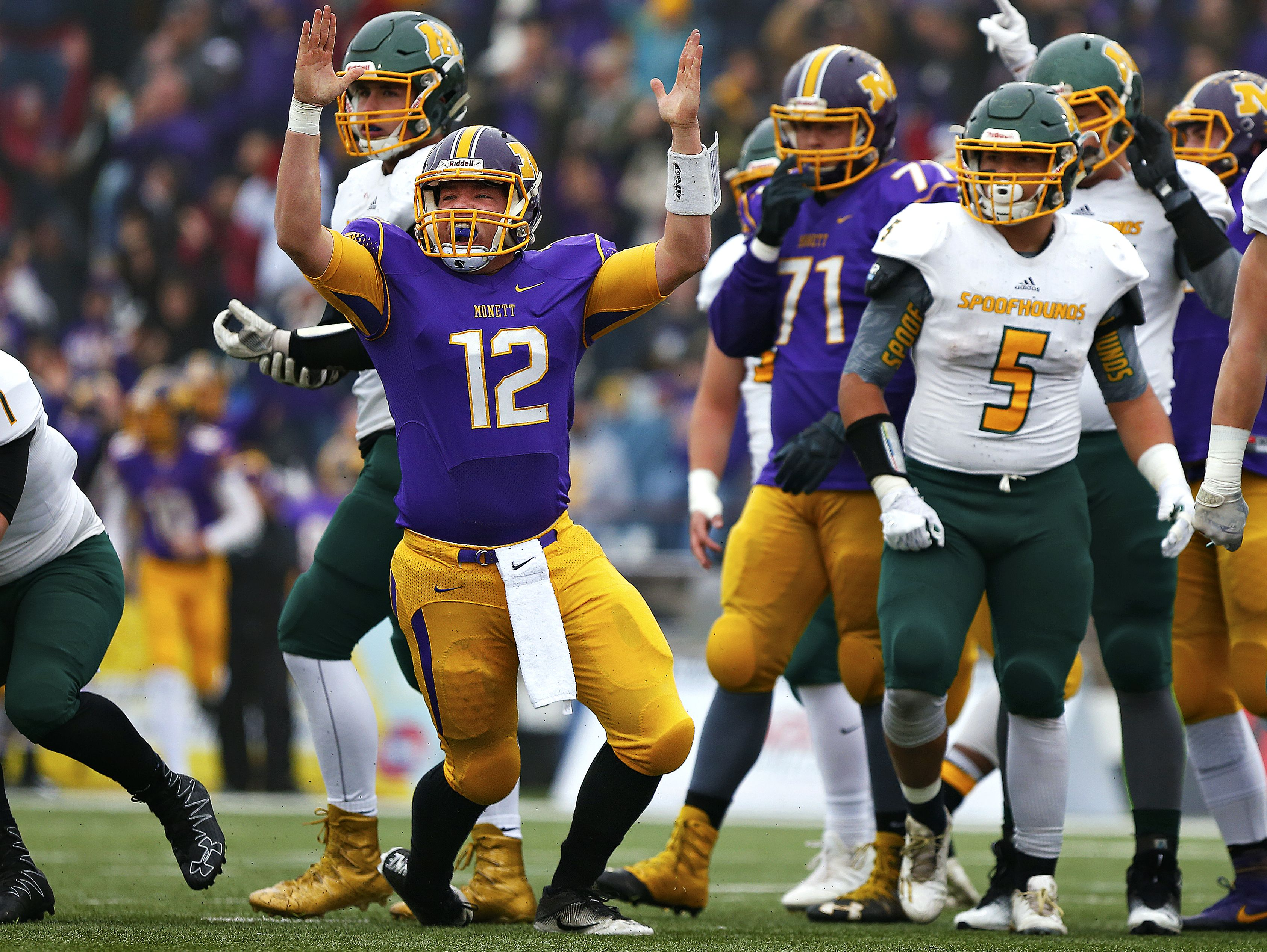 Monett High School quarterback Ian Meyer (12) celebrates after scoring a rushing touchdown during second quarter action of the MSHSAA Class 3 State Championship Game between the Monett High School Cubs and the Maryville High School Spoofhounds at Robert W. Plaster Stadium in Springfield, Mo. on Nov. 26, 2016. The Monett Cubs won the game 27-18.