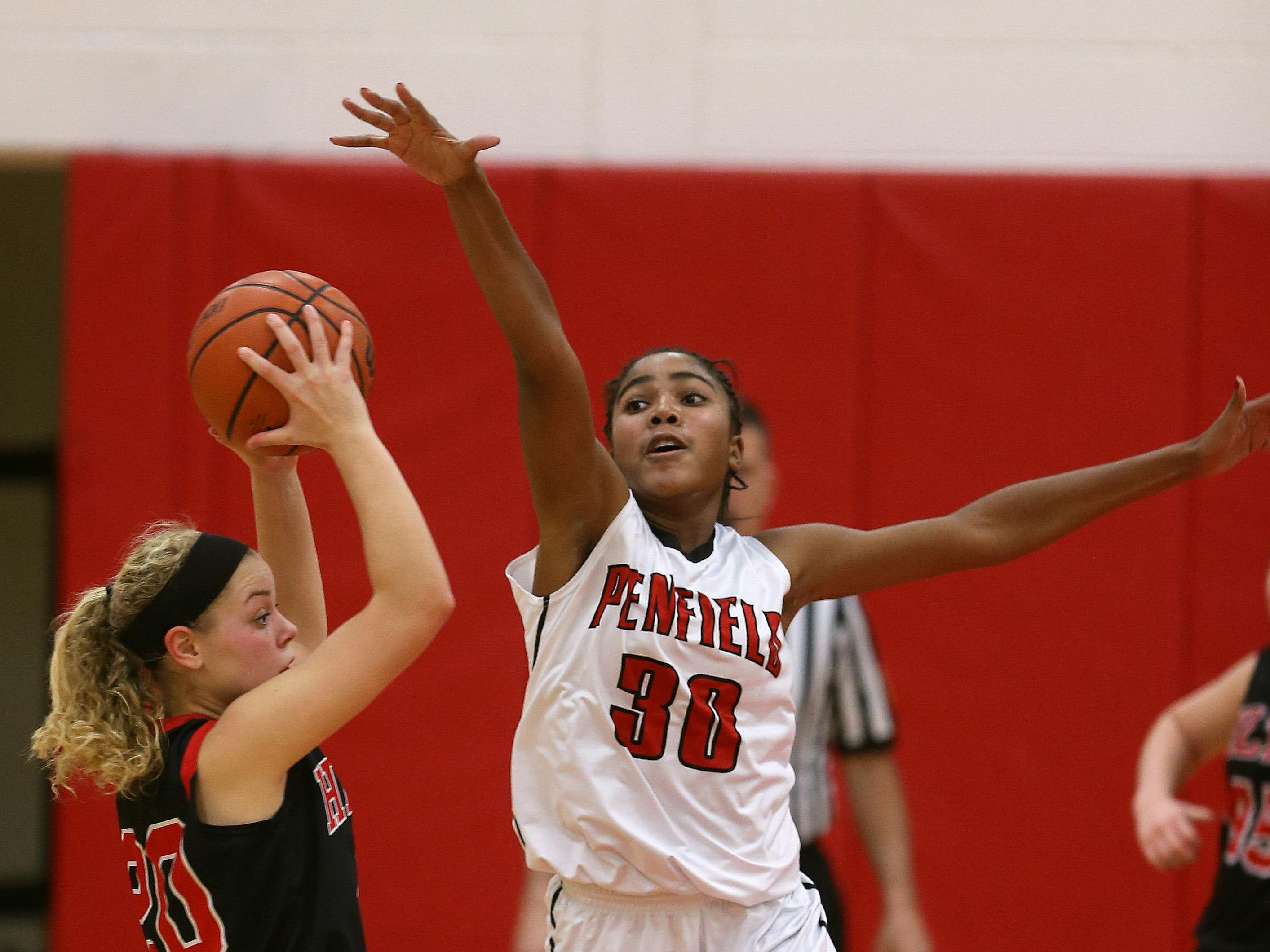 Penfield's Makaila Wilson (30) pressures Hilton's Allyson Strauss, who looks to pass.