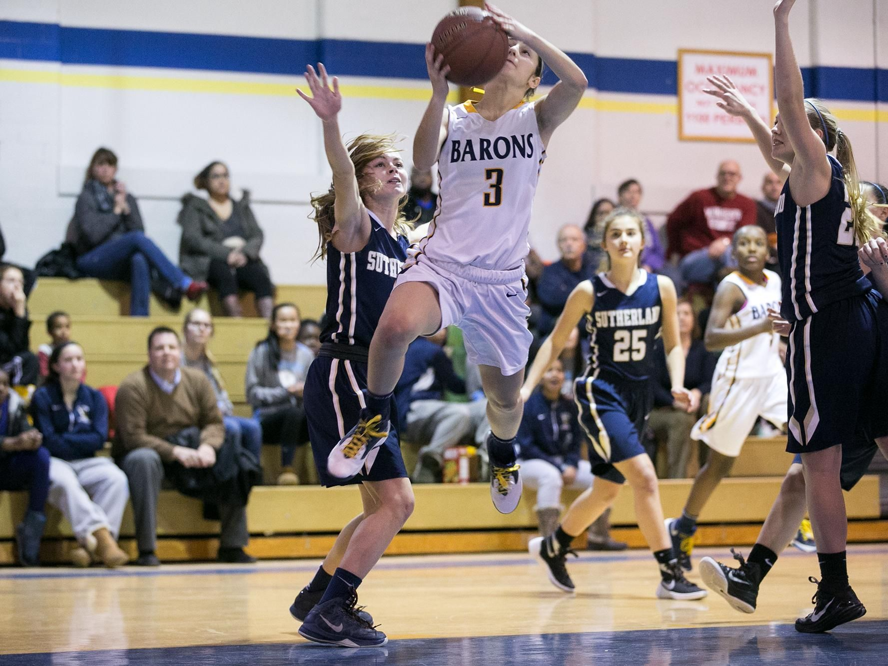 Brighton's Brooke Wolff drives to the hoop during a game against Pittsford Sutherland at Brighton High School on Thursday, Jan. 21, 2016. Wolff was 8-for-8 from the free throw line in the fourth quarter.