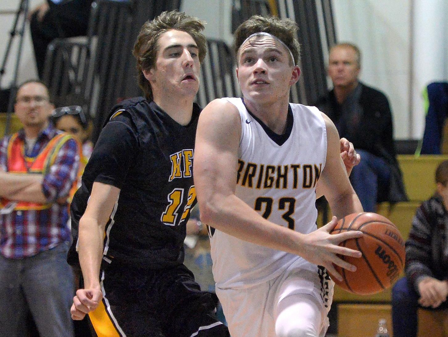 Brighton's Liam Williams, right, drives the baseline past Honeoye Falls-Lima's Coleman Roach on Feb. 3, 2016.