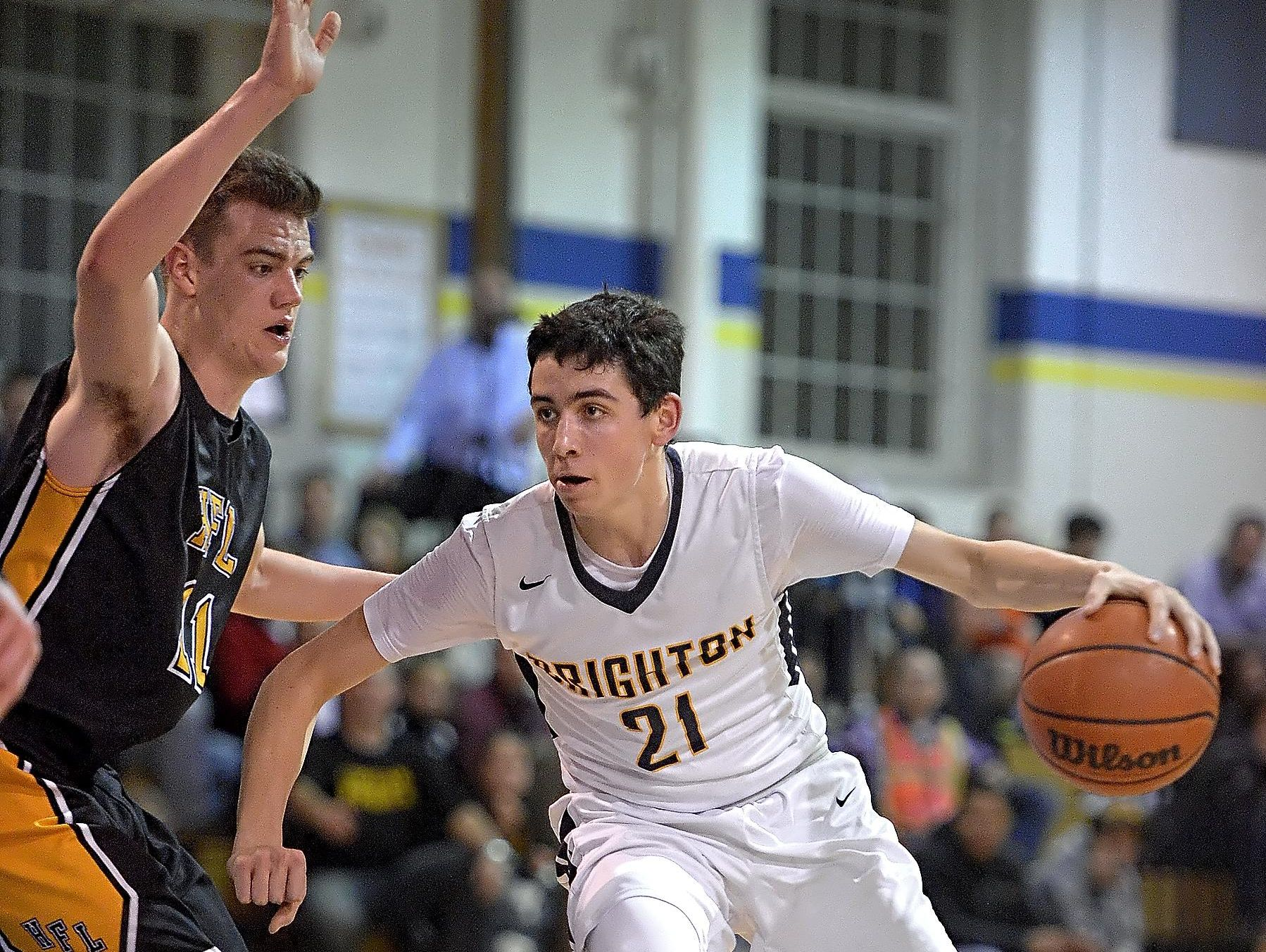 Brighton's Isaac Nelson, right, shields the ball from Honeoye Falls-Lima's Josh D'Agostino on Feb. 3, 2016.
