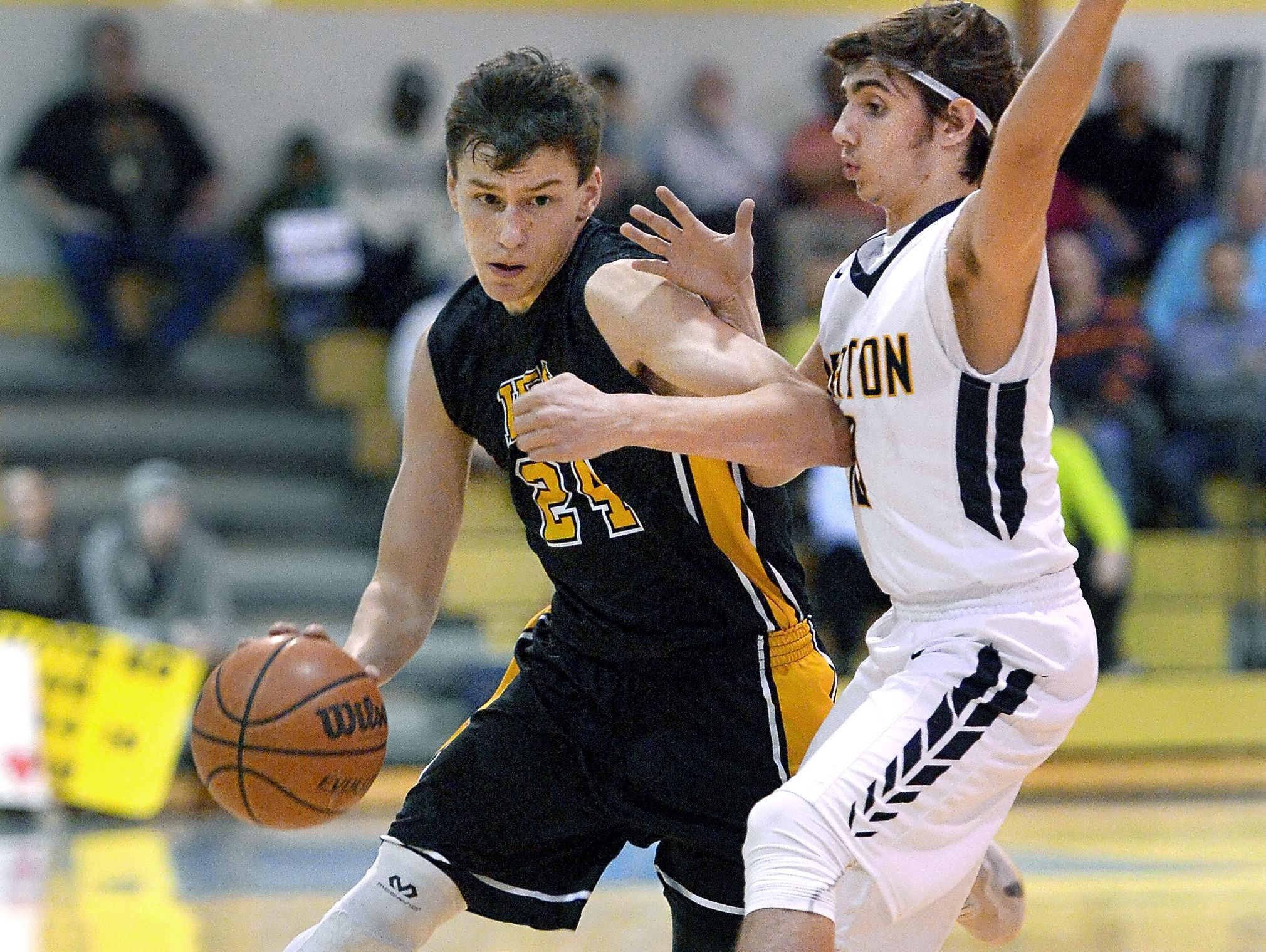 Honeoye Falls-Lima's Tommy Eastman, left, drives by Brighton's Michael Liberti during a game played at Brighton High School on Wednesday, Feb. 3, 2016. Eastman scored 25 points in the game, which HF-L won, 54-43.