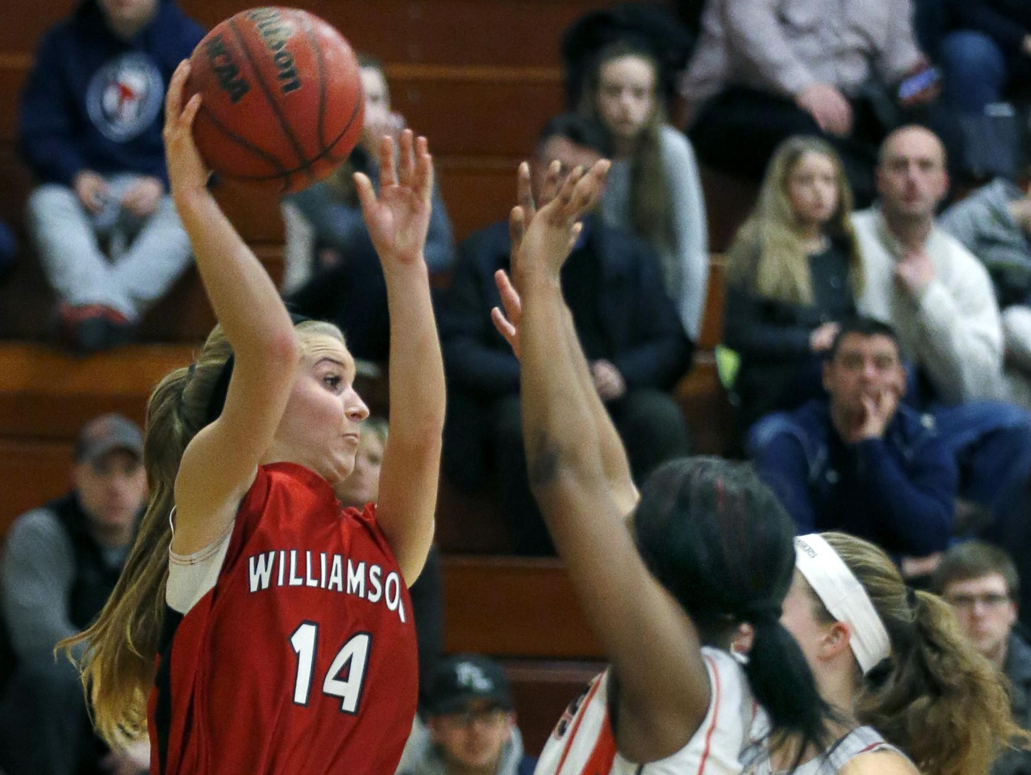 Williamson's Alivia Ginther passes over East Rochester players during the fourth quarter Wednesday at East Rochester High School. East Rochester won, 62-46.