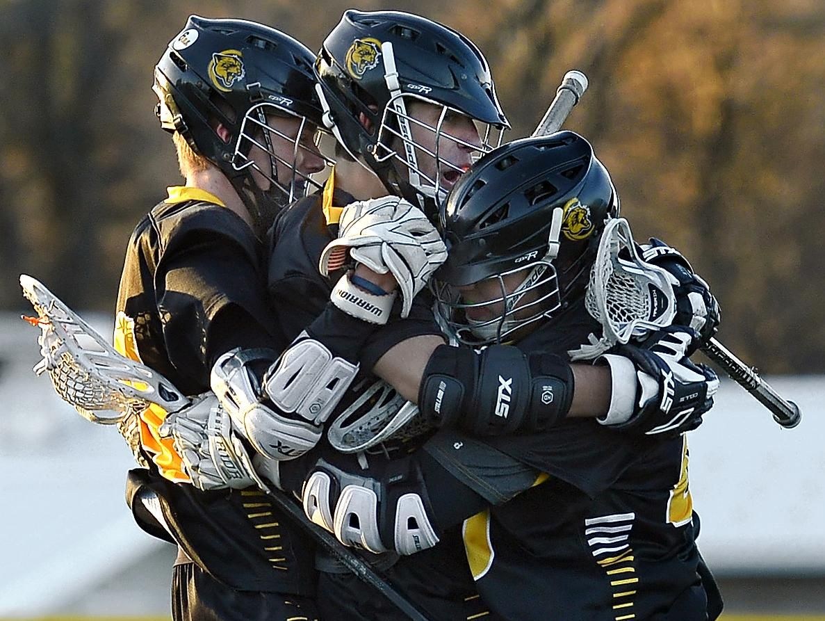 HF-L's Jonathan Roth, center, celebrates his game-winning goal with teammates Dylan Stratton, left, and Charlie Pluta during a regular season game Tuesday at Webster Schroeder High School. Honeoye Falls-Lima beat Webster Schroeder 11-10 in overtime.