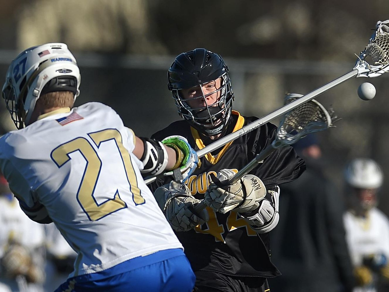 HF-L's Dylan Stratton, right, fires a shot past Webster Schroeder's Eric Jakobsze during a regular season game at Webster Schroeder High School on Tuesday. Honeoye Falls-Lima beat Webster Schroeder 11-10 in overtime.