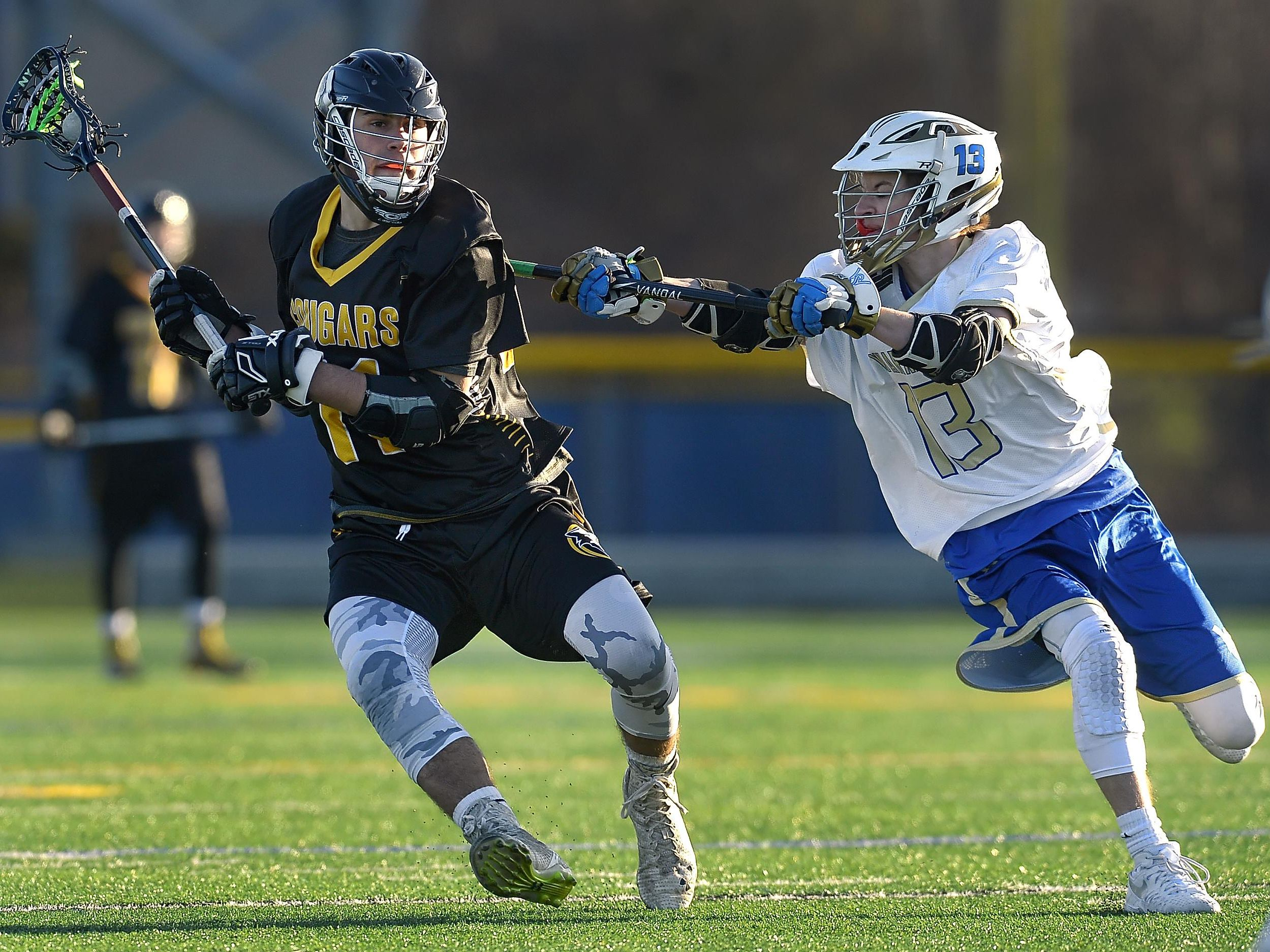 HF-L's Jonathan Roth, left, is defended by Webster Schroeder's Peyton Hall during a regular season game played at Webster Schroeder High School on Tuesday, March 29, 2016. Honeoye Falls-Lima beat Webster Schroeder 11-10 in overtime.