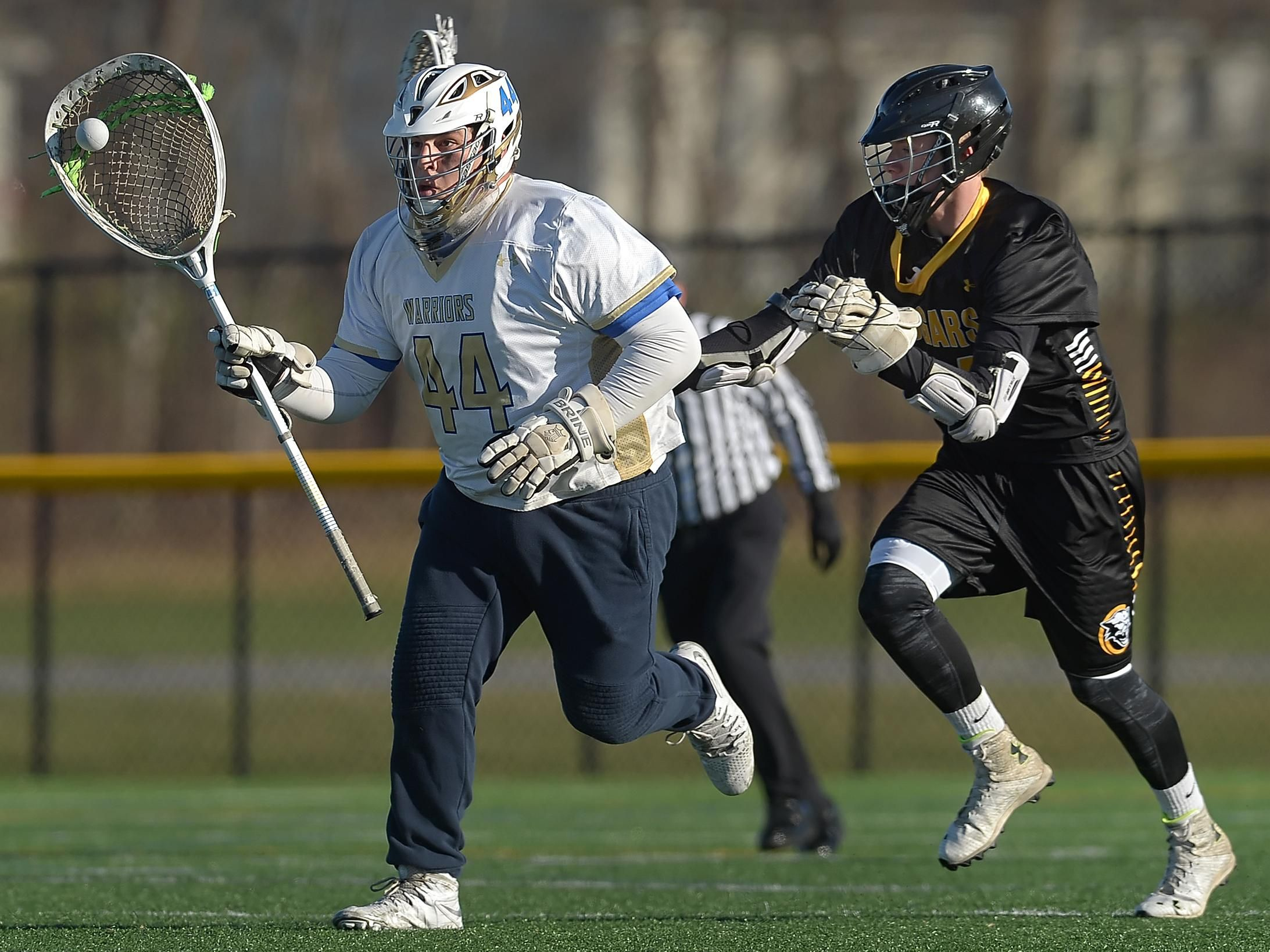 HF-L's Dylan Stratton, right, knocks the ball away from Webster Schroeder goalie Antonio Deleo.