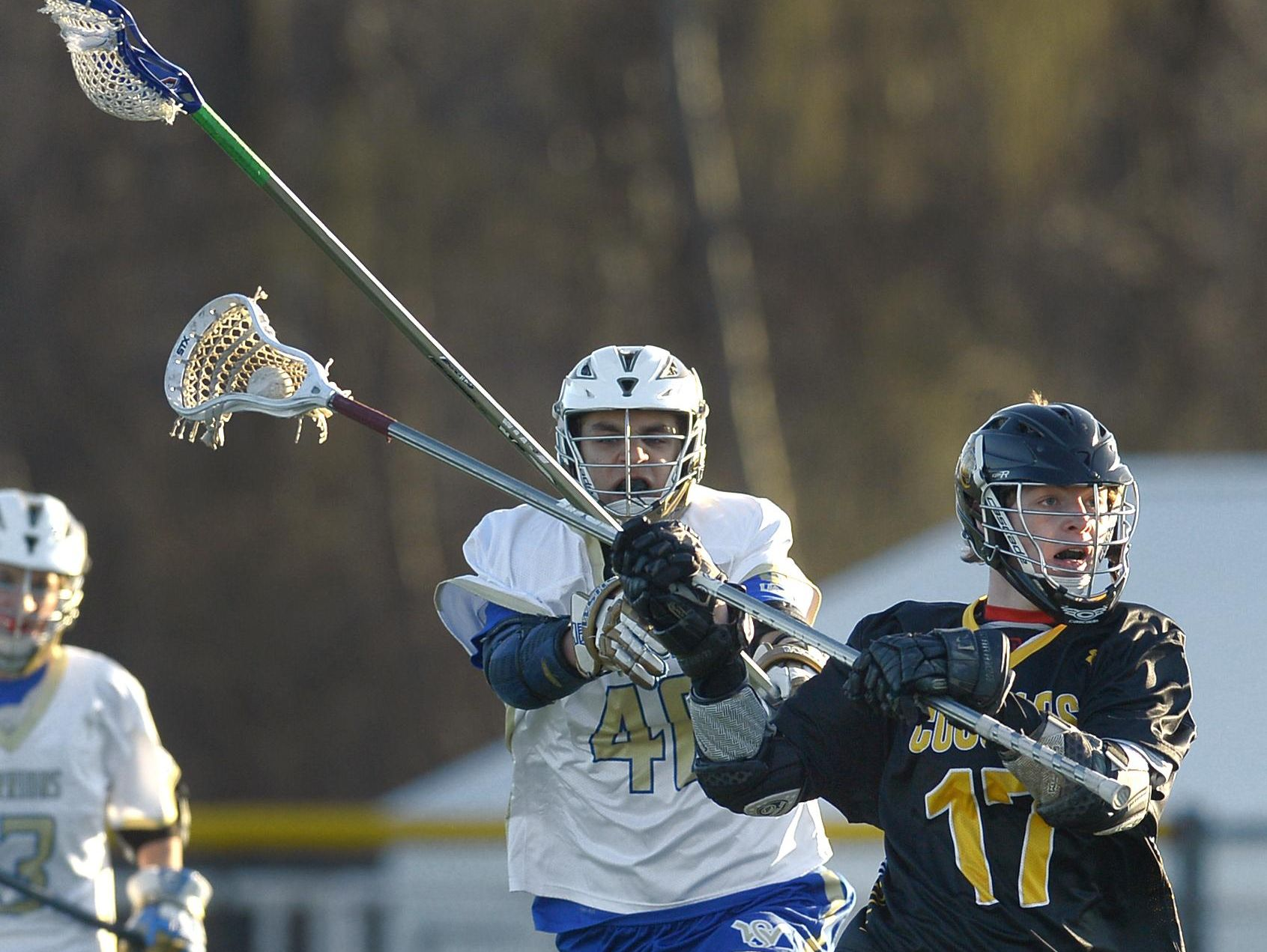 HF-L's Tyler Bushnell, right, is pressured from behind by Webster Schroeder's Jake Coon.