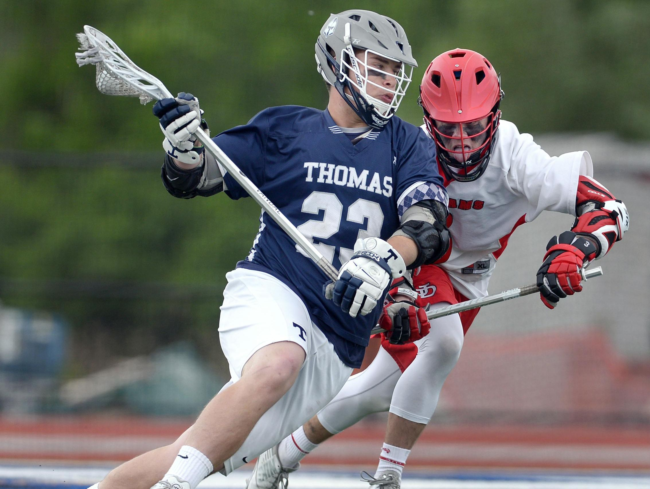 Webster Thomas' Pierce Currie, left, is defended by Jamesville-Dewitt's Matthew Paul during the NYSPHSAA Class B Western Semifinal played at Cicero-North Syracuse High School on Wednesday, June 8, 2016. Webster Thomas' season ended with a 13-9 loss to Jamesville-Dewitt-III.