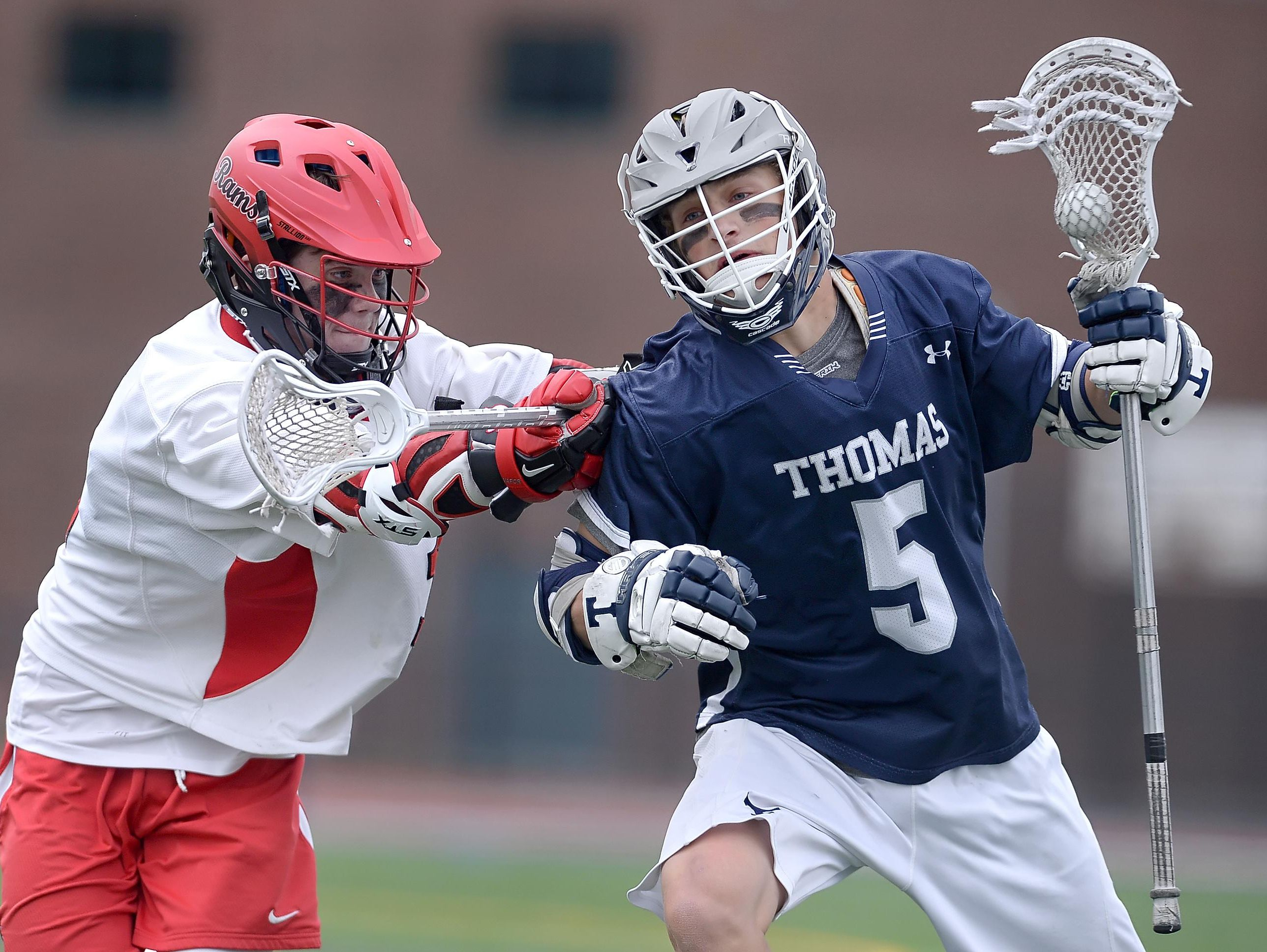 Webster Thomas' Matt Hill, right is defended by Jamesville-Dewitt's Matthew Paul during the NYSPHSAA Class B Western Semifinal played at Cicero-North Syracuse High School on Wednesday, June 8, 2016. Webster Thomas' season ended with a 13-9 loss to Jamesville-Dewitt-III.