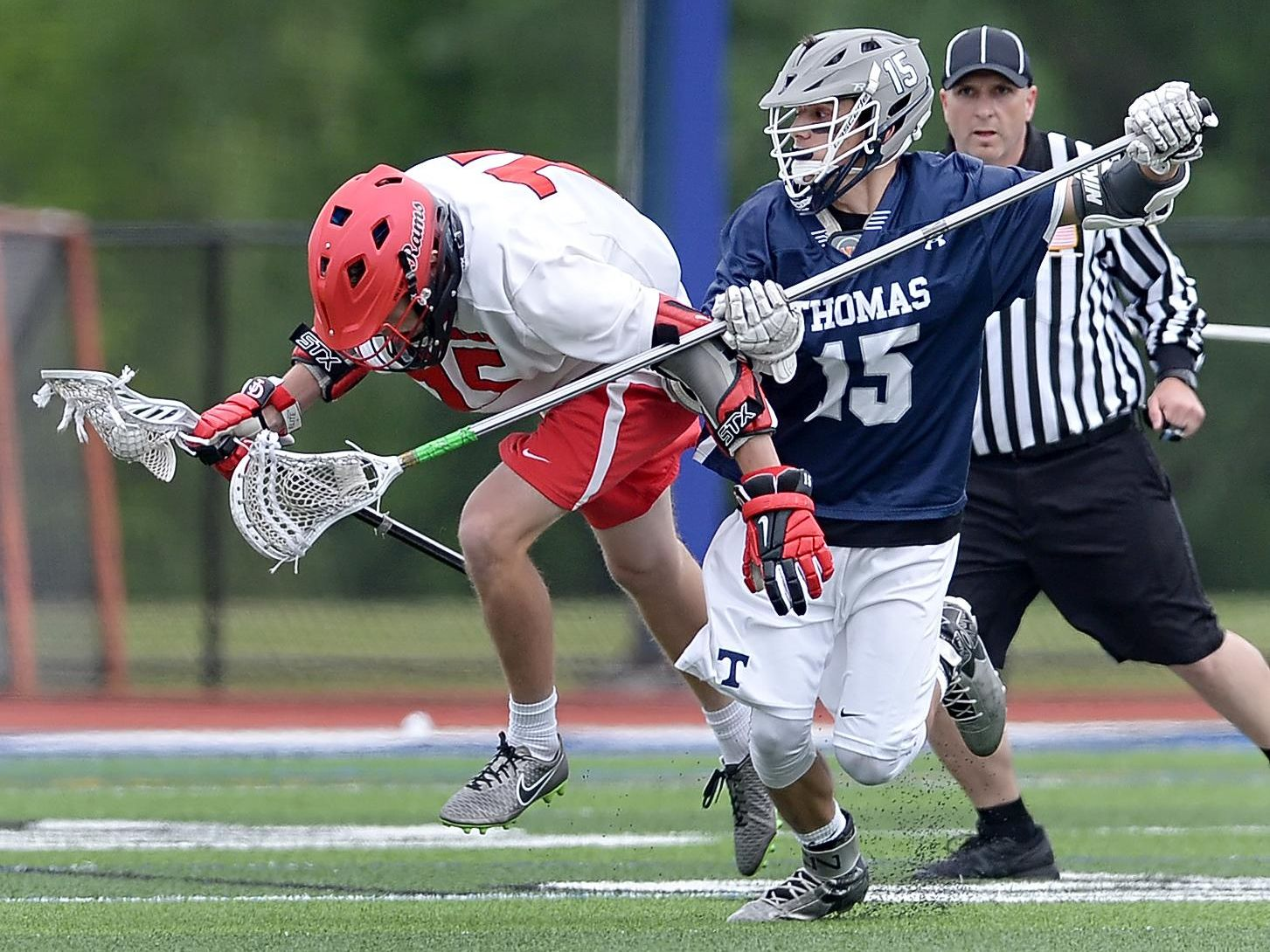 Webster Thomas' C.J. Battaglia, right, pressures Jamesville-Dewitt's Andrew Barclay during the NYSPHSAA Class B Western Semifinal played at Cicero-North Syracuse High School on Wednesday, June 8, 2016. Webster Thomas' season ended with a 13-9 loss to Jamesville-Dewitt-III.