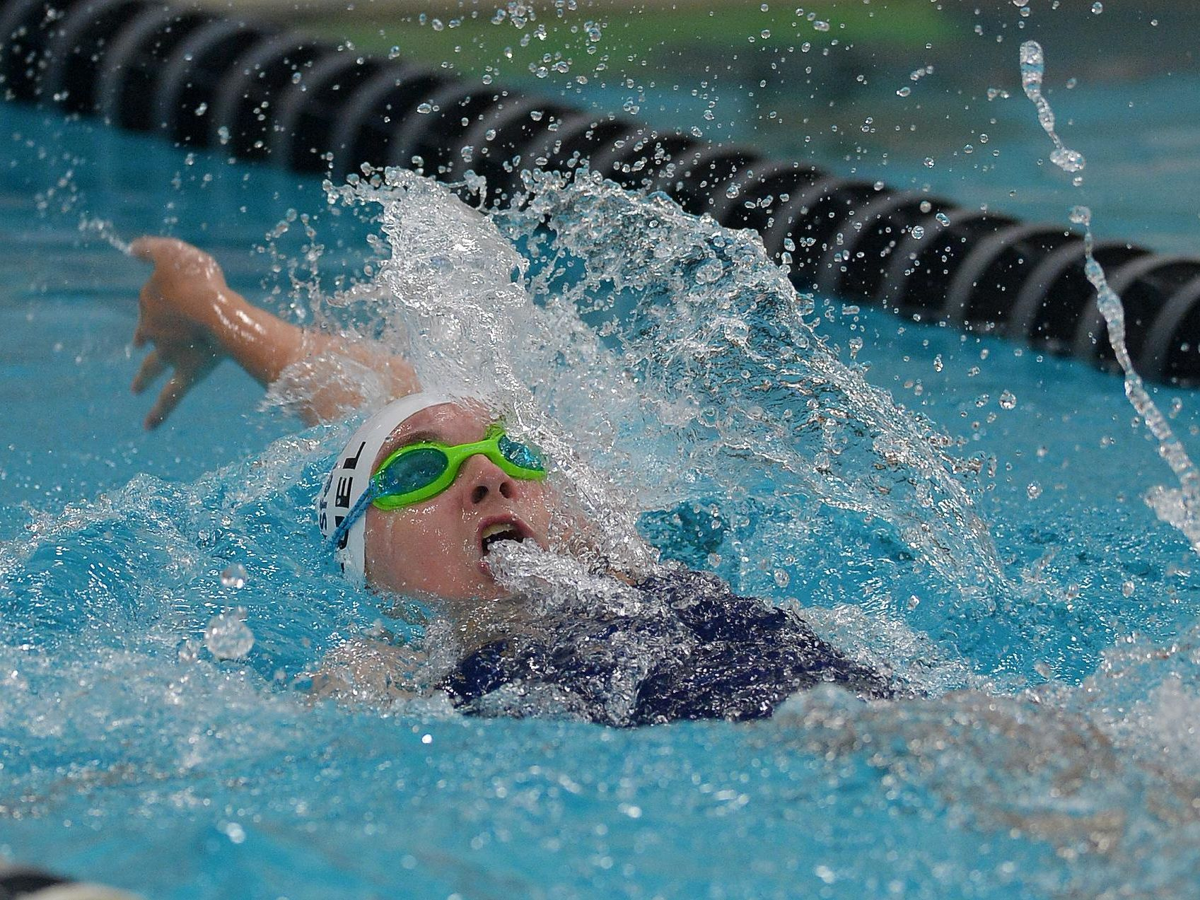 Pittsford's Megan Deuel swims the 100 yard backstroke.