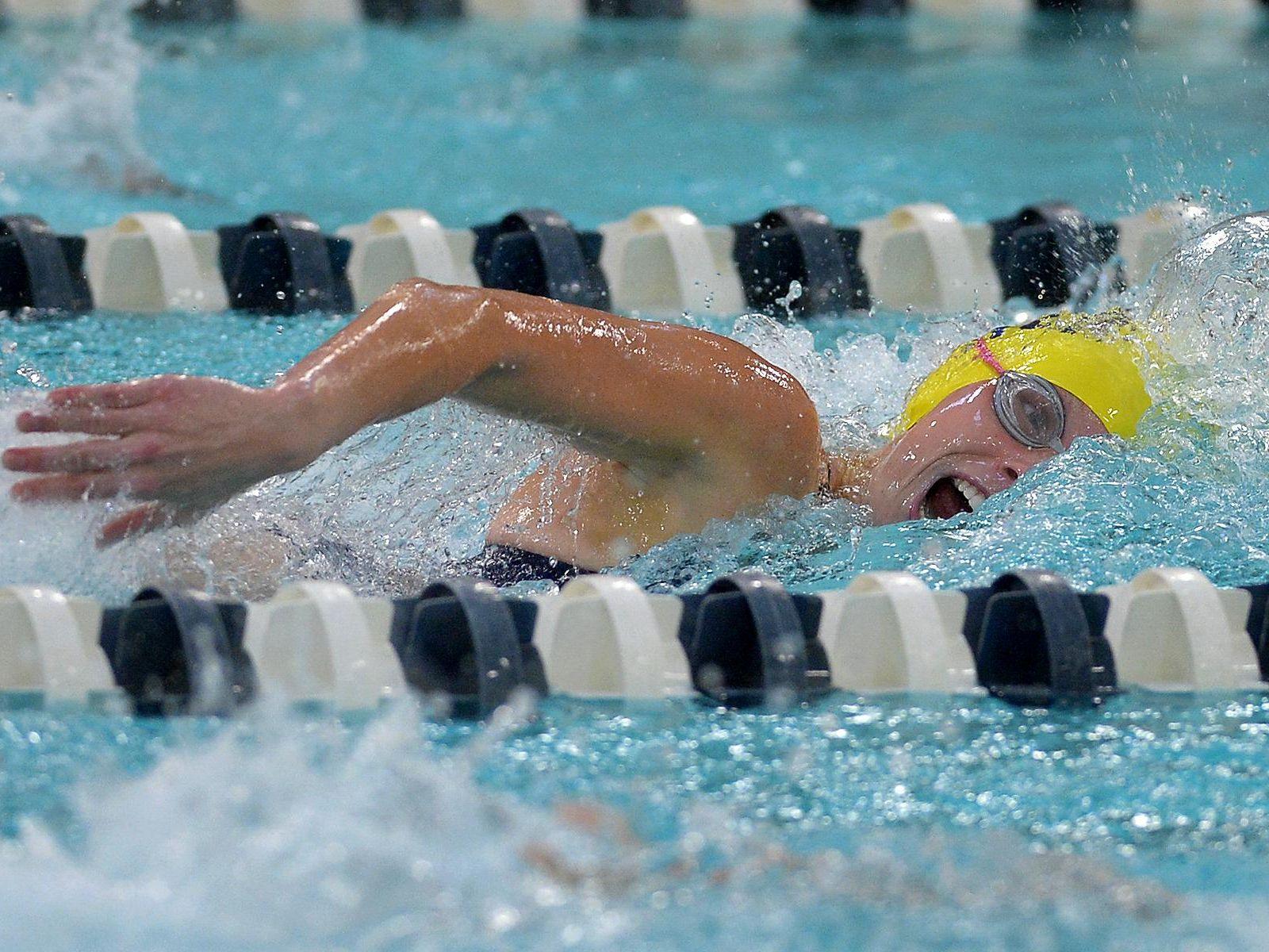 Victor's Caroline Wood swims the 100 yard freestyle.