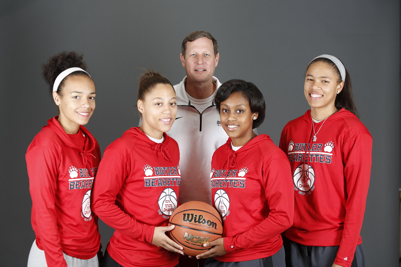 Butler High School girl's basketball coach Larry Just, with players Tasia Jeffries, left, Teri Goodlett, Breia Torrens and Jaelynn Penn, on right. Nov. 7, 2016.