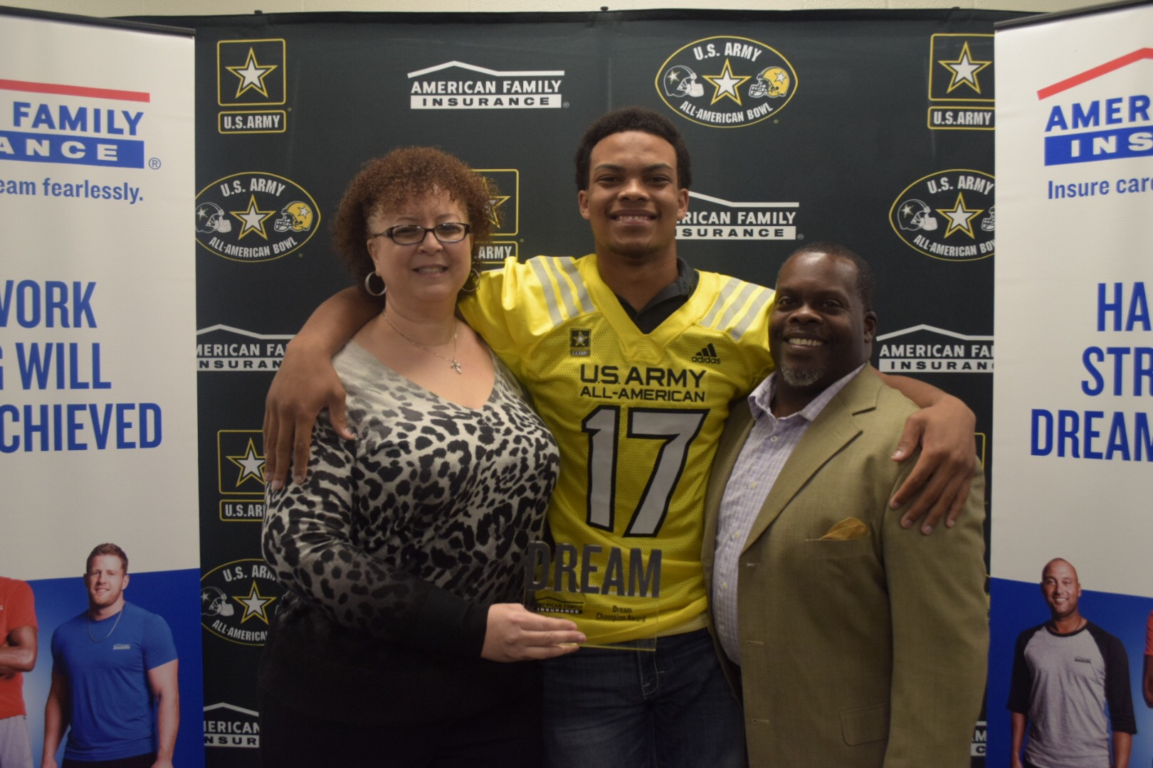 Earnest Brown presented his parents, Angela and Earnest Brown III, with the Dream Champion Award. (Photo: AAG)