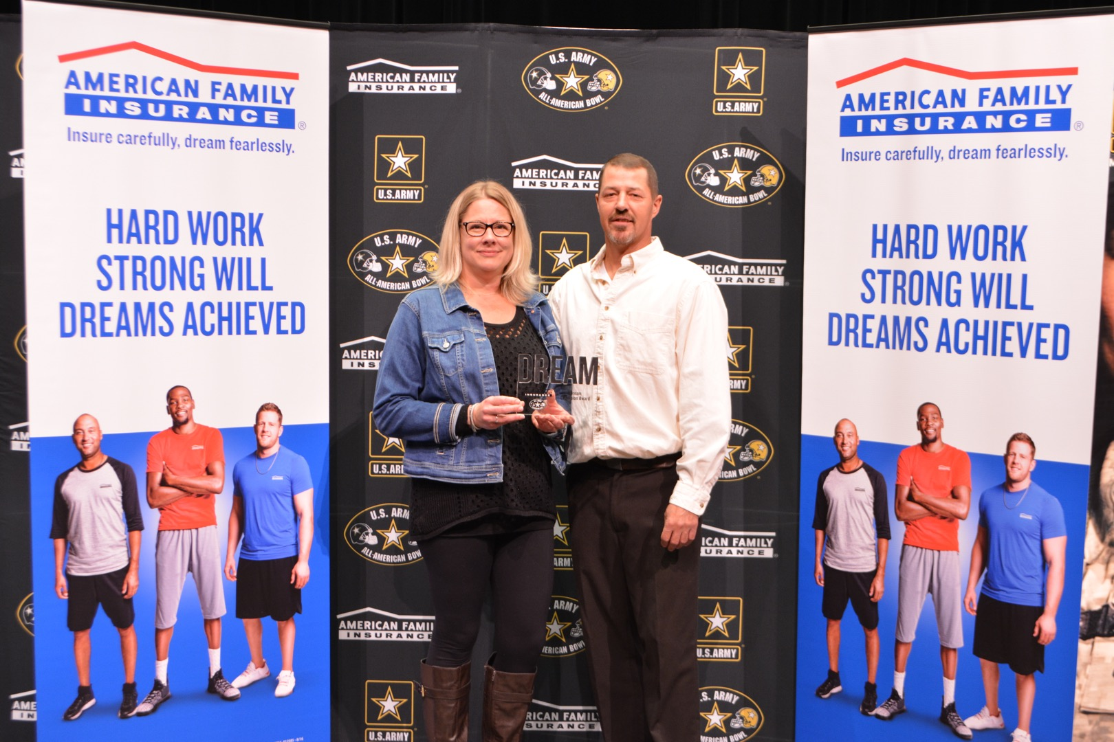 Linda and Paul Granzow, the parents of Lake Orion High senior U.S. Army All-American Color Guard member Emily Graznow, are presented with their daughter's American Family Insurance Dream Champion award. (Photo credit: U.S. Army All-American Bowl)