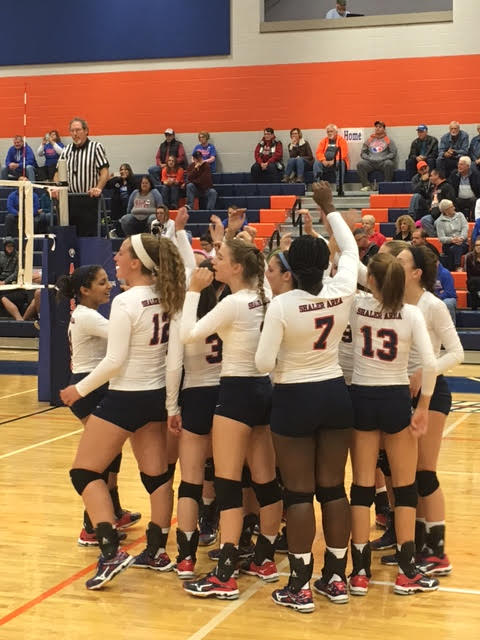 Girl's volleyball team huddles before game against Armstrong Photo Credit; Amanda O'Connor