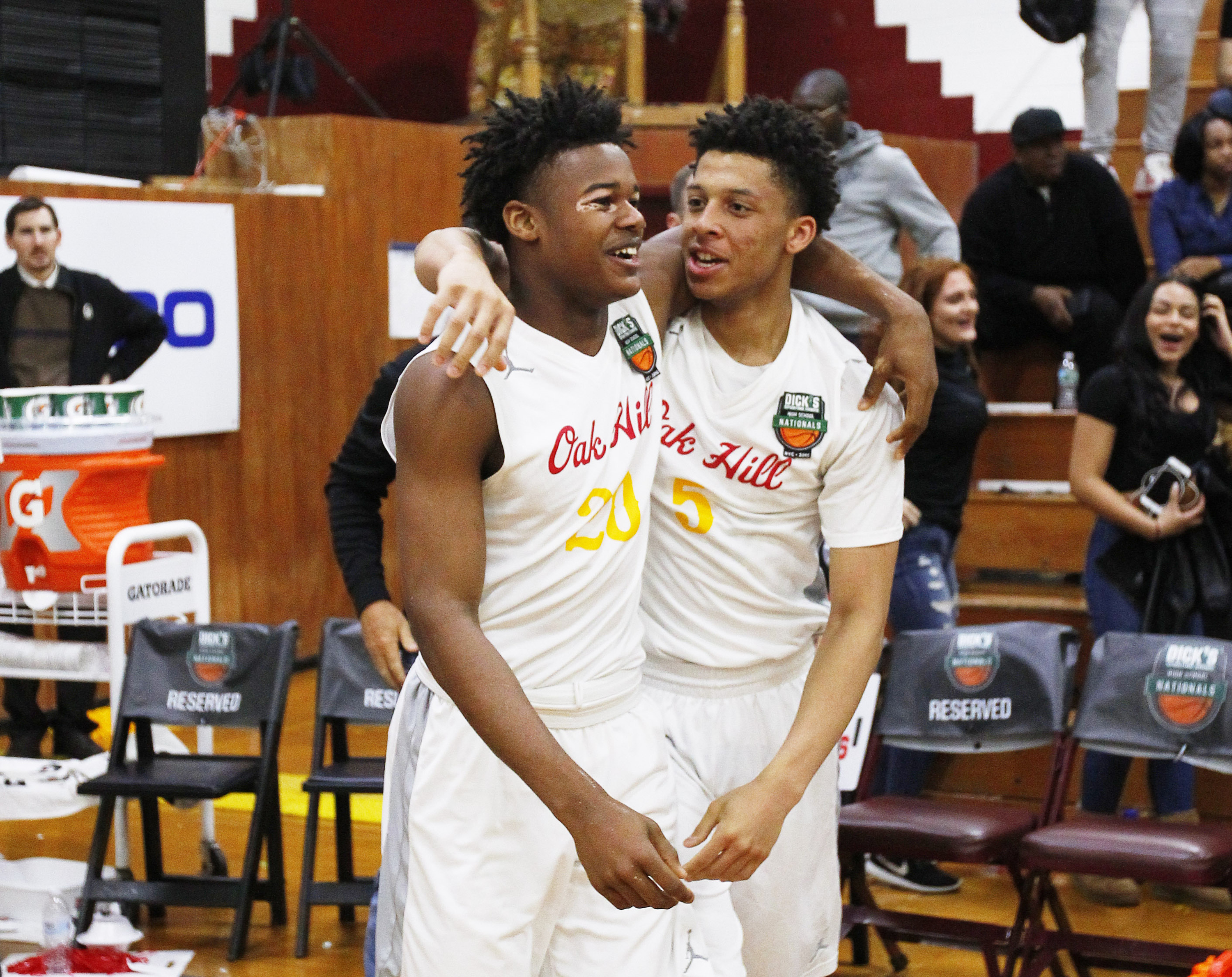 4/1/2016 1:00AM -- Middle Village, NY, U.S.A -- Oak Hill Academy guards Devonte Shuler (20) and Lindell Wigginton (5) react after defeating Miller Grove during Dick's Sporting Goods High School Nationals at Christ the King Regional high school. Oak Hill defeated Miller Grove 47-46.-- Photo by Andy Marlin USA TODAY Sports Images, Gannett ORG XMIT: US 134676 Dick's basketbal 4/1/2016 [Via MerlinFTP Drop]