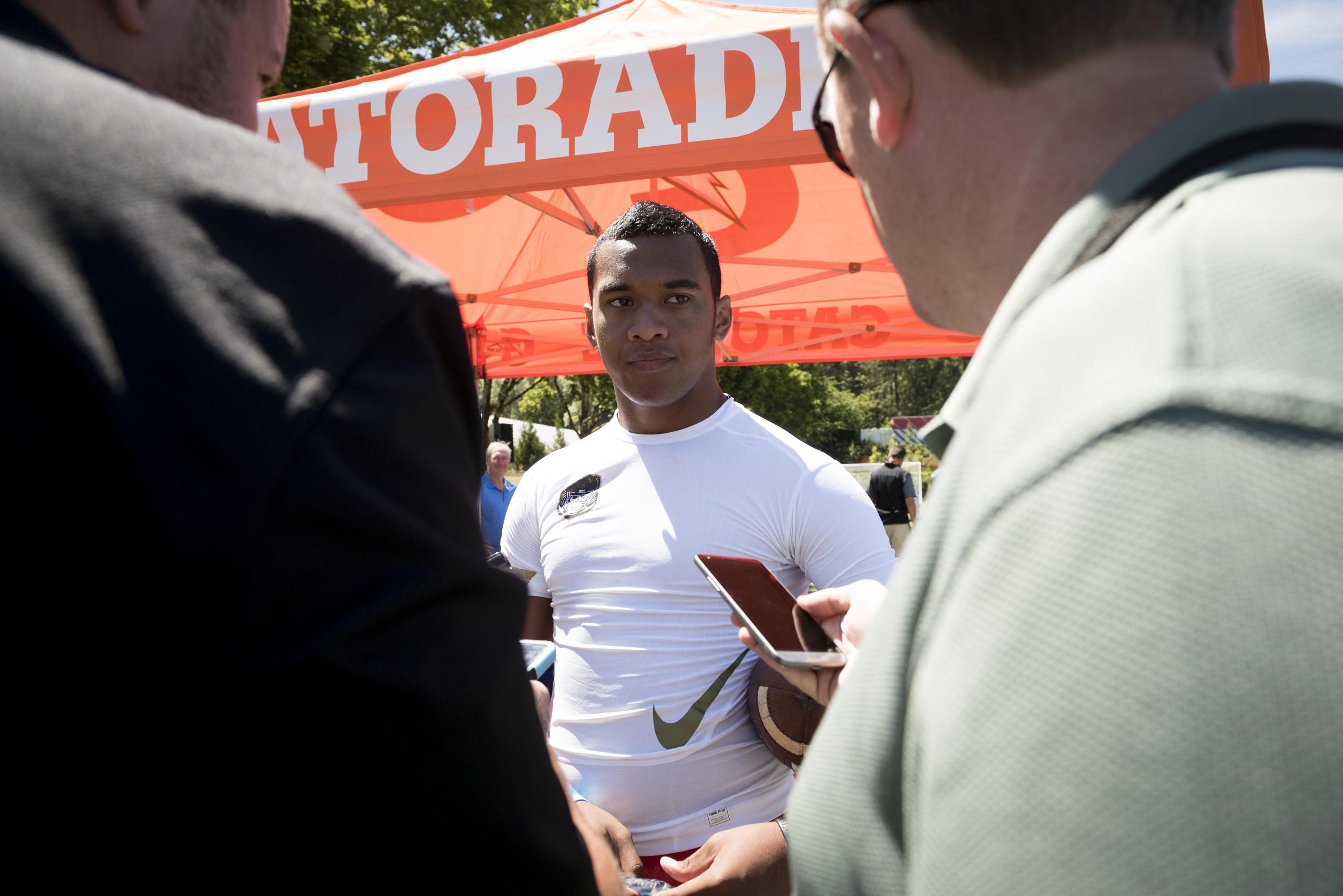 July 6, 2016 -- Beaverton, OR, U.S.A -- Quarterback Tua Tagovailoa of St. Louis (Hawaii) talks to the media at The Opening and Elite 11 high school football camp at Nike headquarters in Oregon. -- Photo by Troy Wayrynen-USA TODAY Sports Images, Gannett ORG XMIT: US 135130 opening/ elite 1 7/6/2016 [Via MerlinFTP Drop]