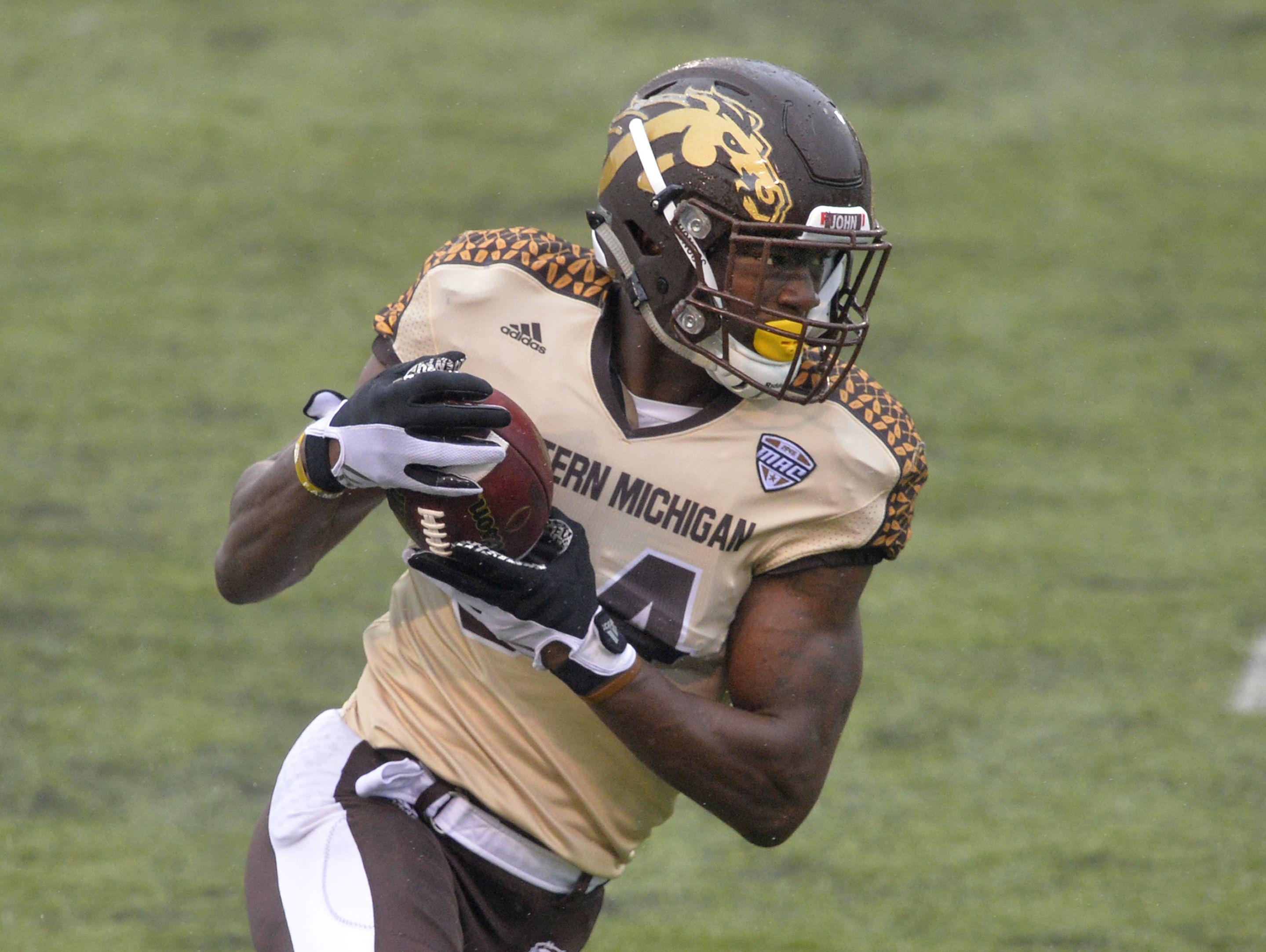 In this Nov. 27, 2015, file photo, Western Michigan wide receiver Corey Davis runs with the ball for a 30-yard touchdown reception against Toledo in an NCAA college football game in Toledo, Ohio.