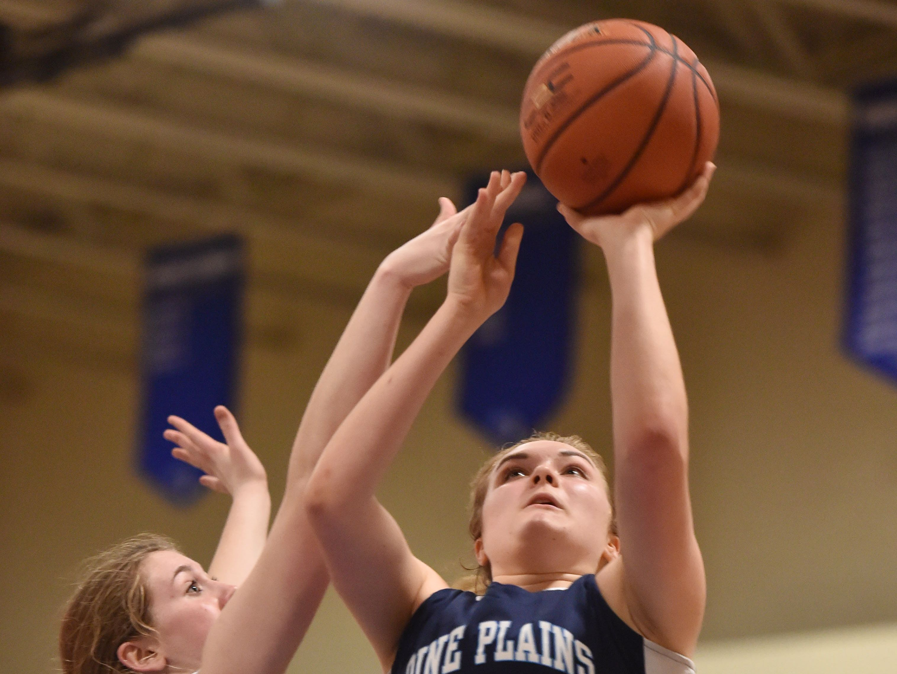 Pine Plains' Bella Starzyk goes up for a shot against Seward in the Section 9 Class C final last February.