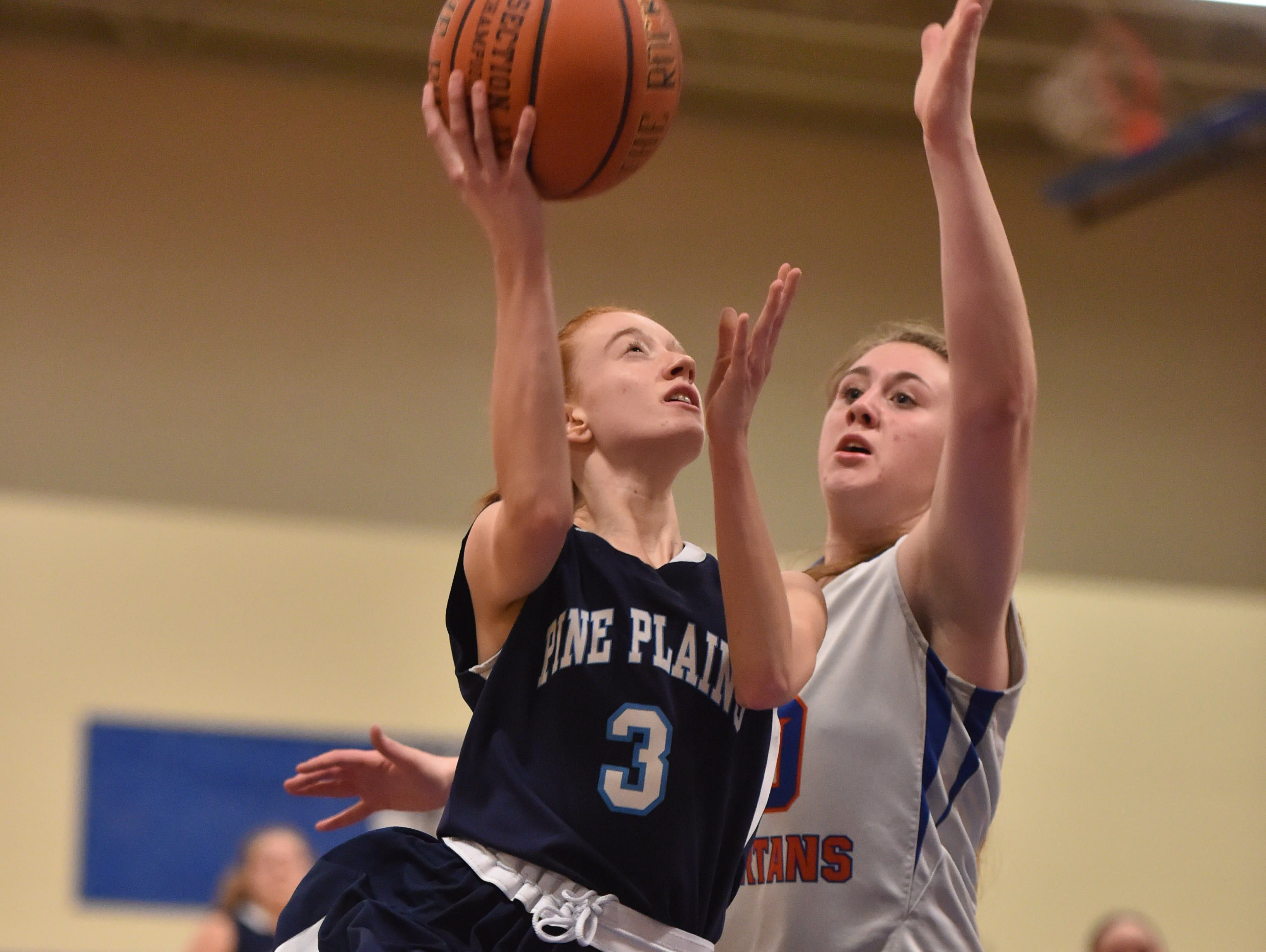 Pine Plains' Frances Snyder attempts a layup against S.S. Seward in the Section 9 Class C final last February.