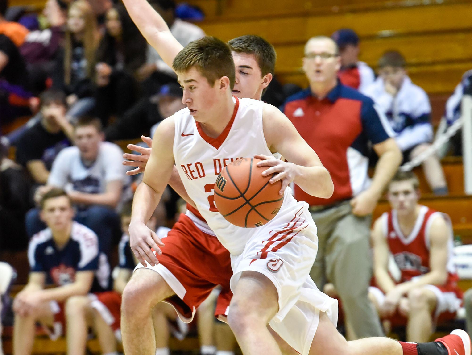 Bedford North Lawrence Braxton Day (24) blocks Jeffersonville Red Devils Bailey Falkenstein (24) during first half of play in the 106th Annual IHSAA Boys Basketball State Tournament Class 4A sectional game at Seymour High School in Seymour, Ind. Mar. 1, 2016