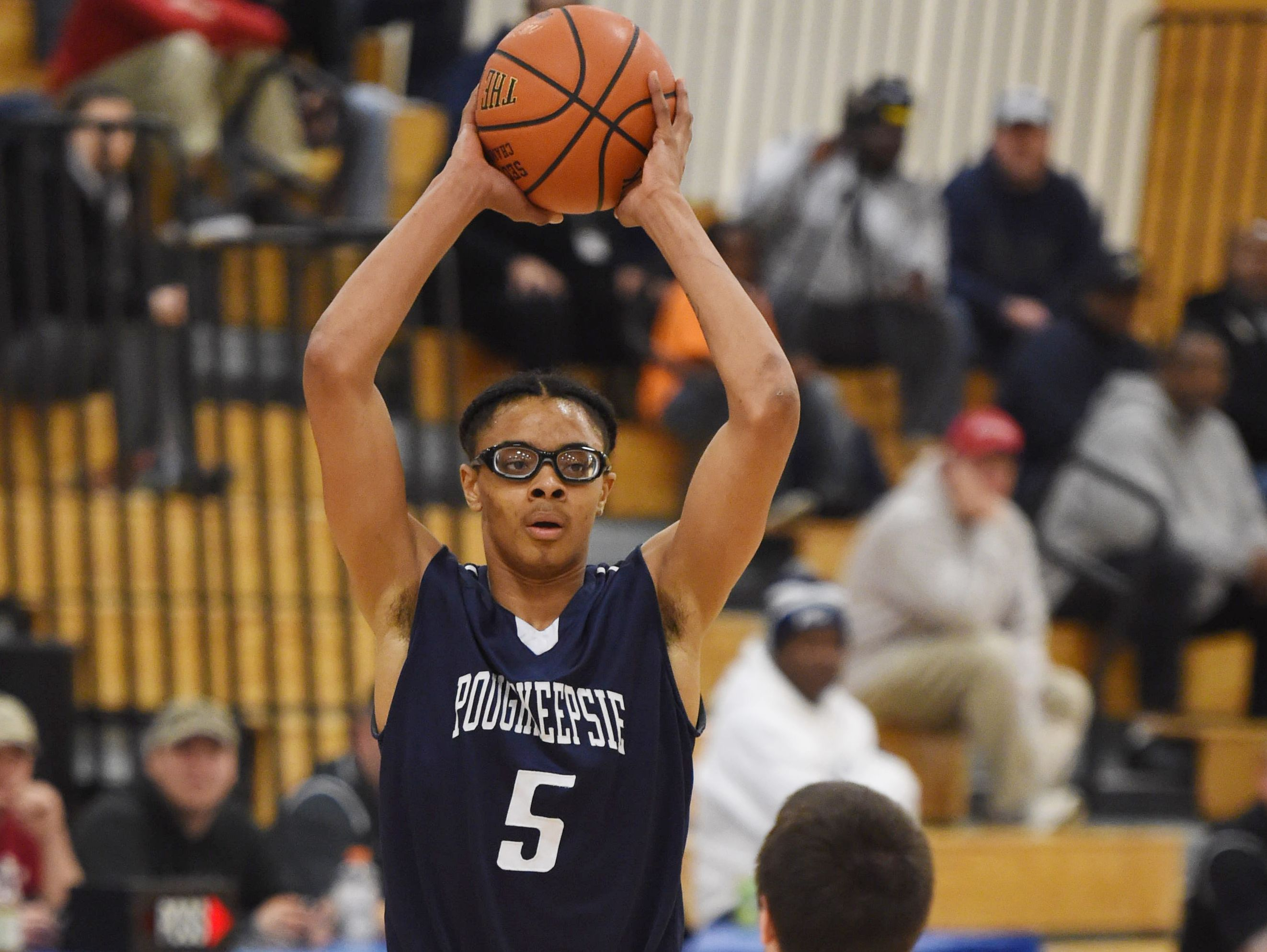 Poughkeepsie High School's Caval Haylett looks for a teammate to pass the ball to during a game versus Red Hook on Feb. 17, 2016.