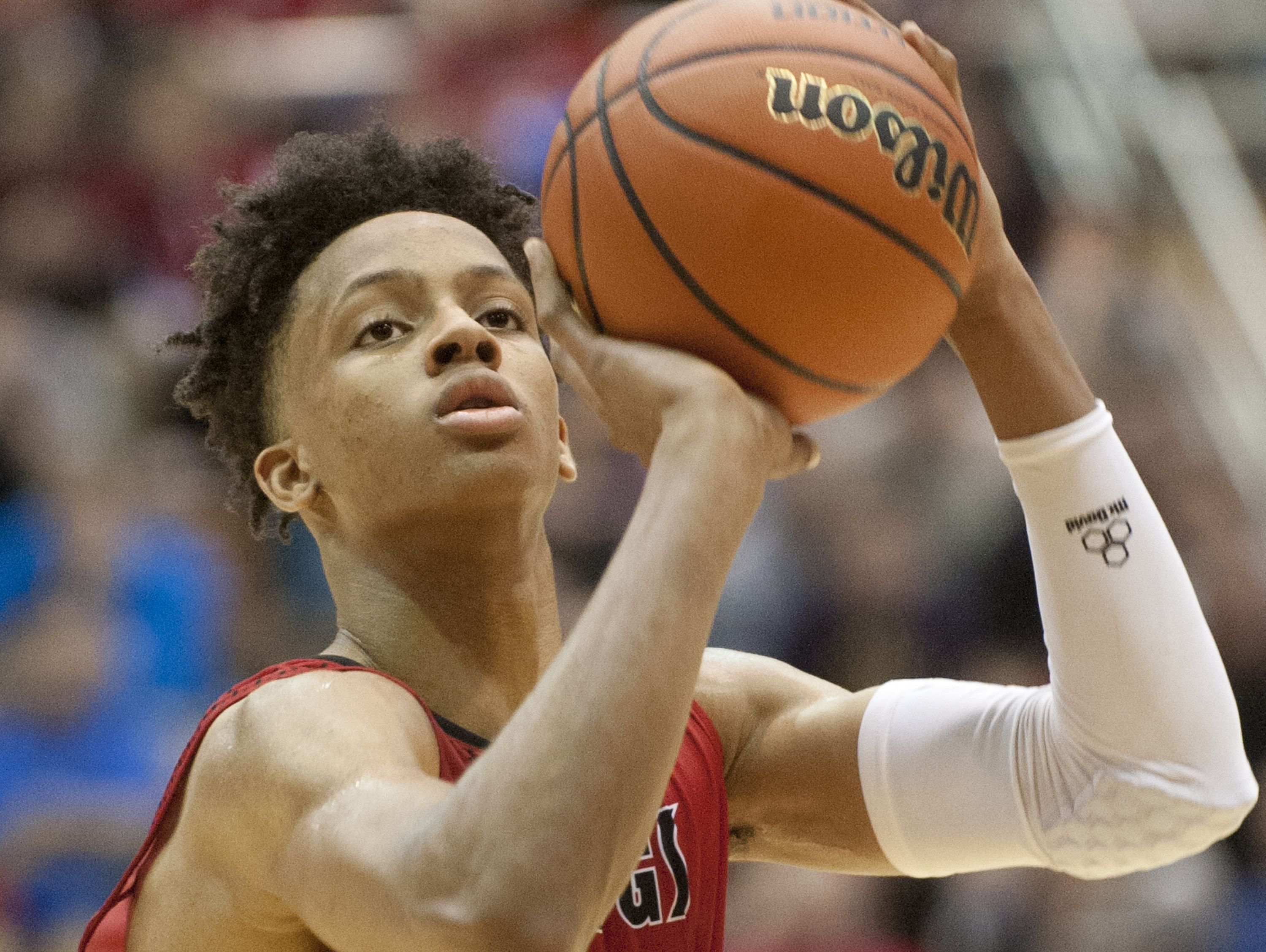 New Albany Bulldogs guard-forward Romeo Langford shoots a free throw in the Indiana High School Athletic Association Boys Seymour Regional. 12 March, 2016