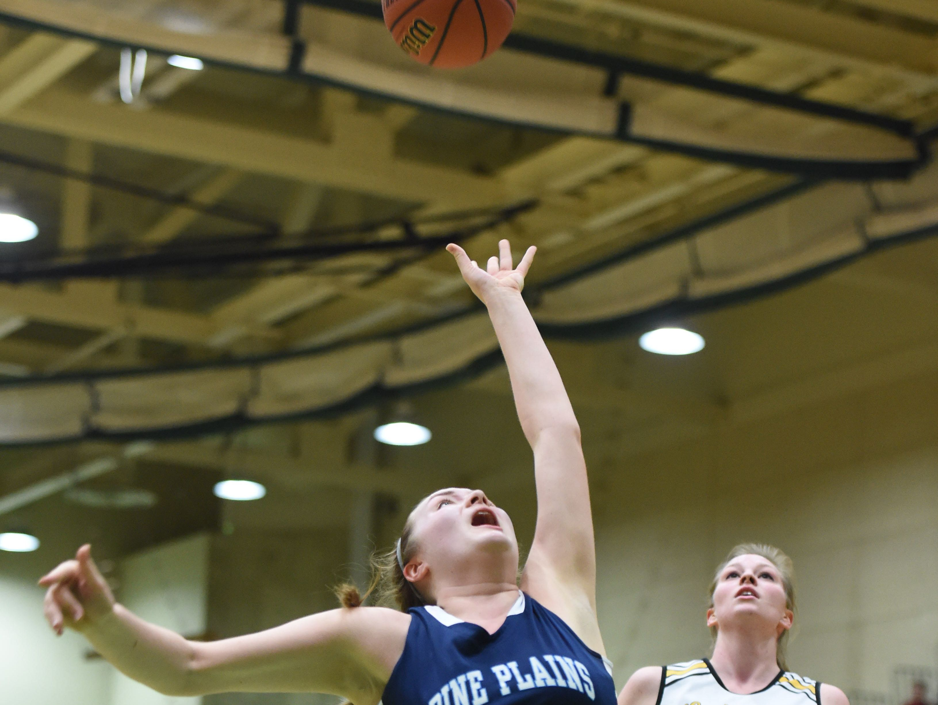 Pine Plains' Bella Starzyk goes for a layup during the state Class C final in March.