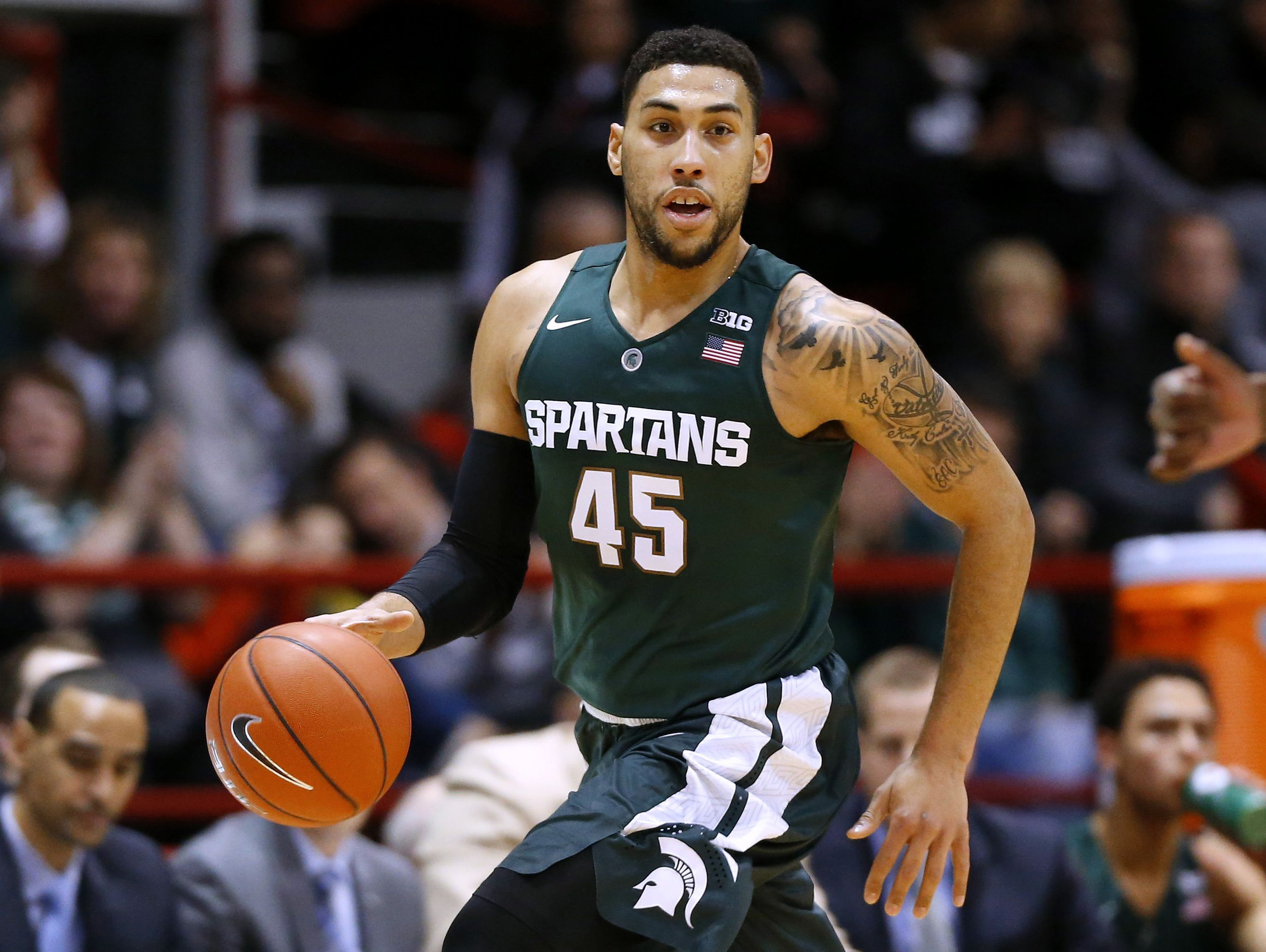 In this Dec. 19, 2015, file photo, Michigan State's Denzel Valentine brings the ball upcourt during the first half of an NCAA college basketball game against Northeastern in Boston.