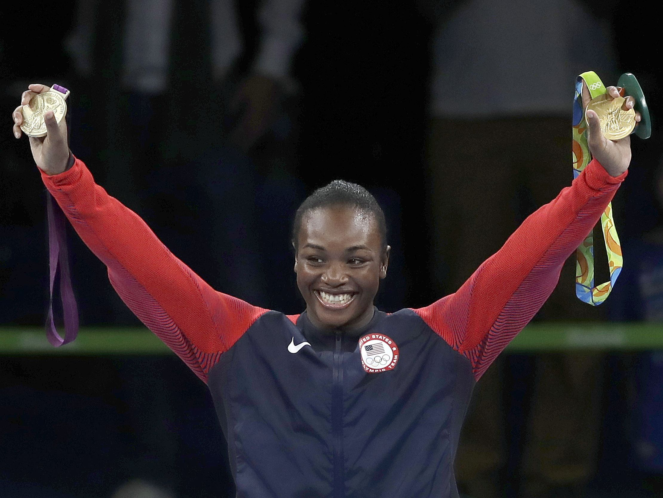 United States' Claressa Shields displays her gold medals - from London and from Rio - for the women's middleweight 75-kg boxing at the 2016 Summer Olympics in Rio de Janeiro, Brazil, Sunday, Aug. 21, 2016.