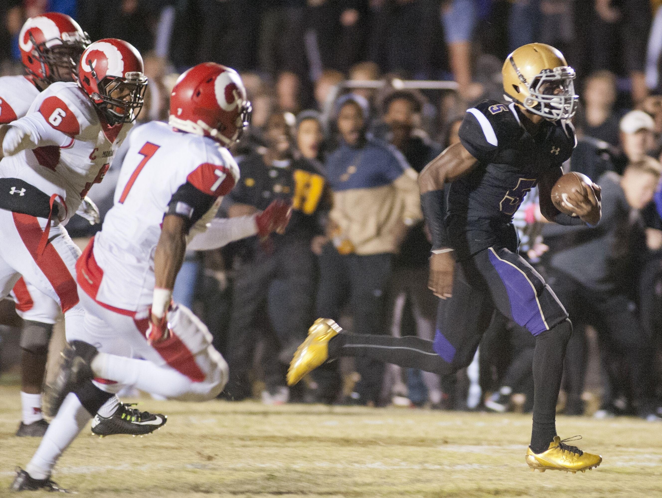 L-R: Manual defensive back Keon Farris, Manual outside linebacker Andre Teague, Jr. and Manual defensive back Bryce Cosby can't catch Male wide receiver Nathan Hobbs who scores the only touchdown of the 1st half with just 23.4 seconds to play. 21 October 2016