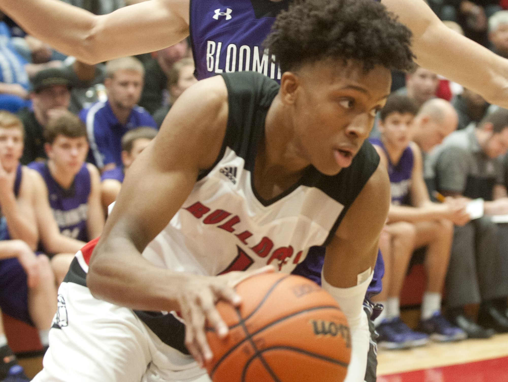New Albany guard-forward Romeo Langford drives around Bloomington South forward Josh Hall. 26 November 2016