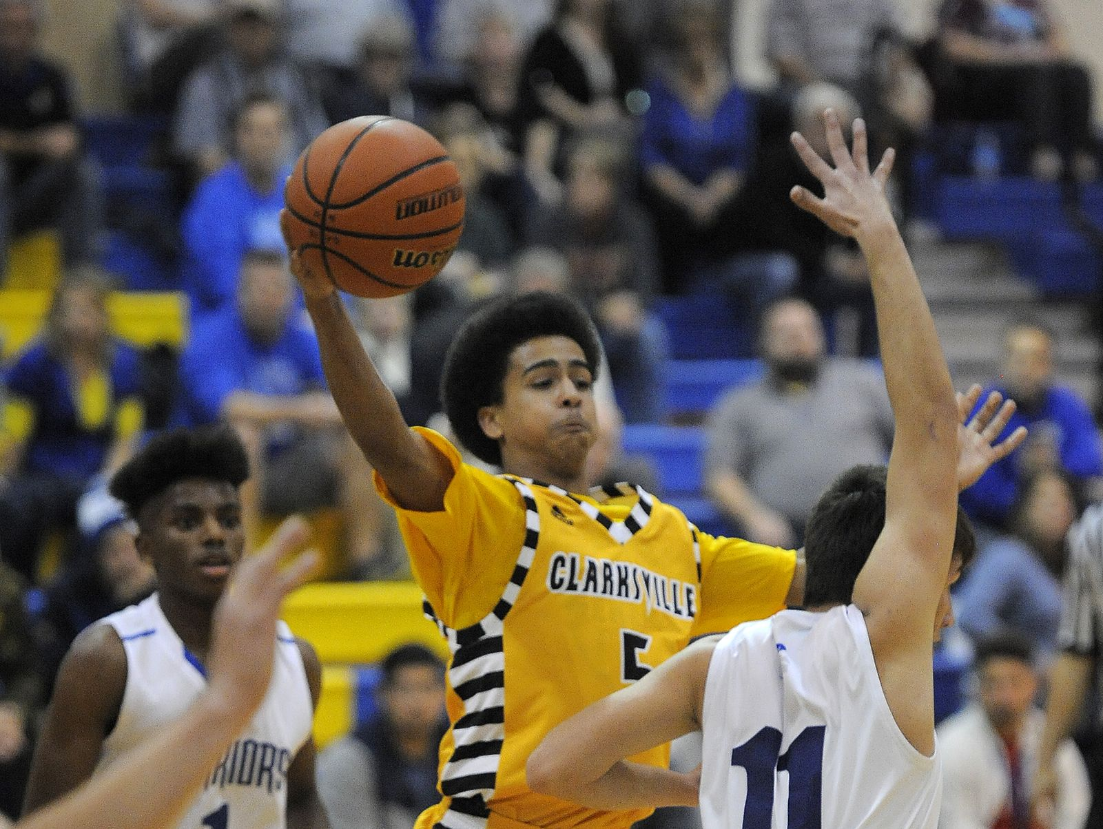 Clarksville's Charles VanWinkle (5) looks to pass against Christian Academy on Tuesday at Christian Academy High School.