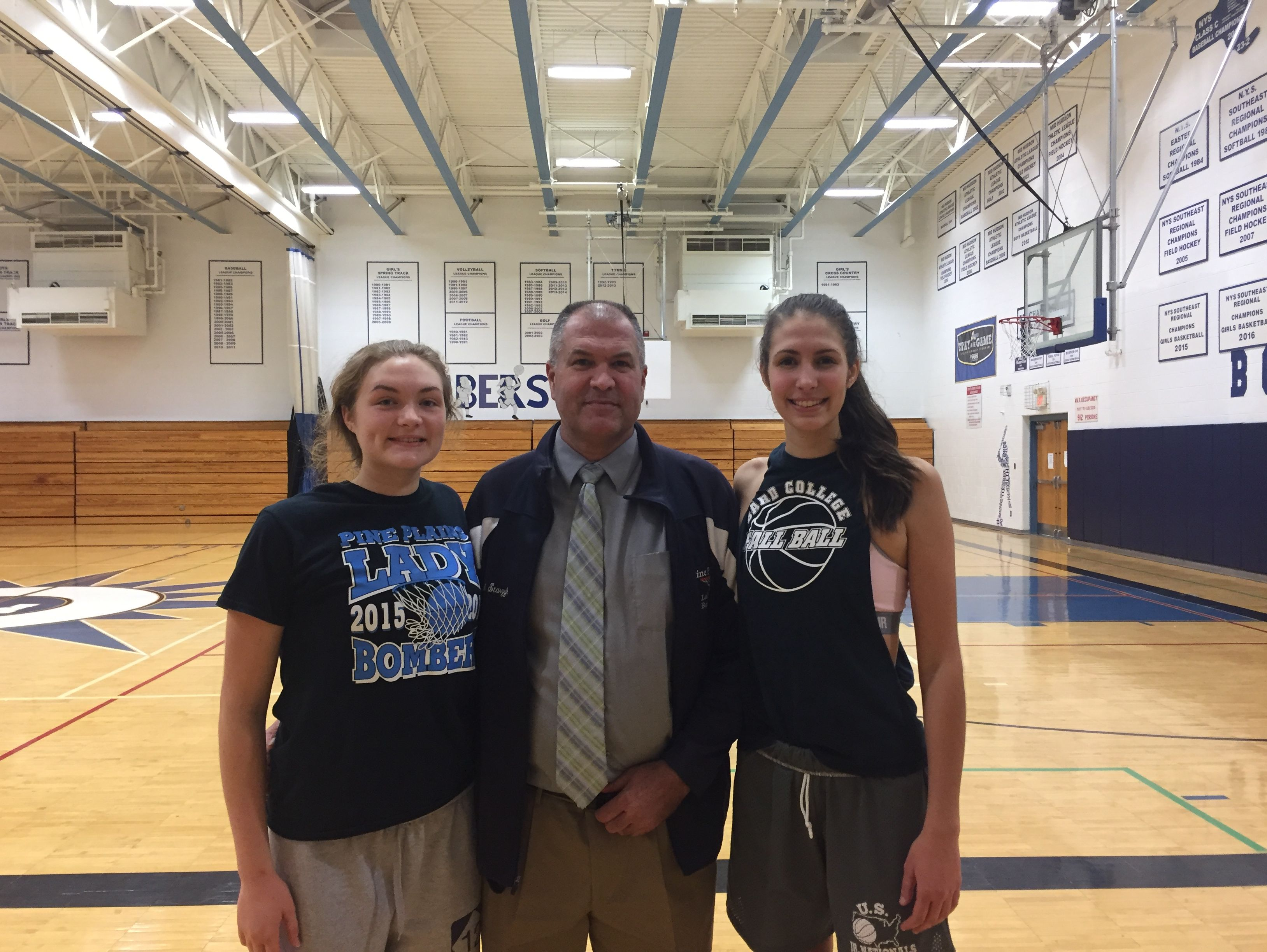 From L to R: Bella Starzyk, Rich Starzyk, Ashley Starzyk of the Pine Plains girls basketball team.