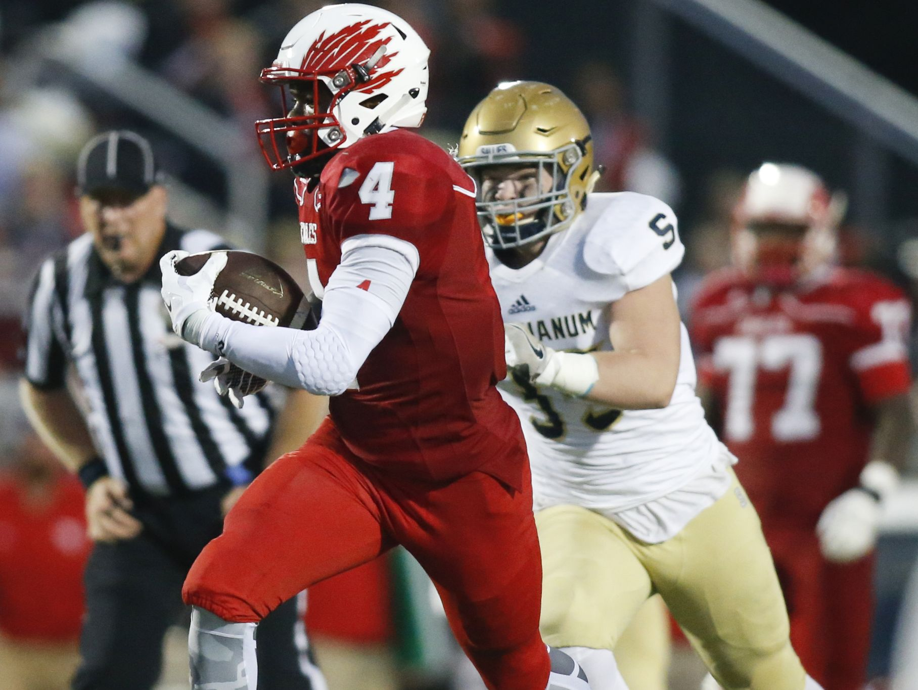 Smyrna offensive lineman Jerren Carter (77) watches after helping to spring running back Leddie Brown (4) for a touchdown Sept. 23 against Salesianum.