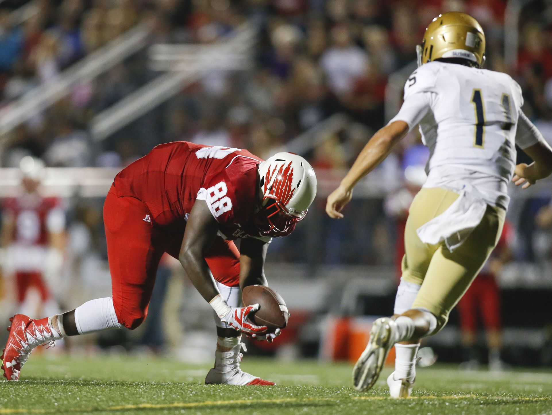 Smyrna defensive lineman Jamier Smith grabs a fumble in front of Salesianum quarterback Zach Gwynn during the Eagles' 60-26 win on Sept. 23.