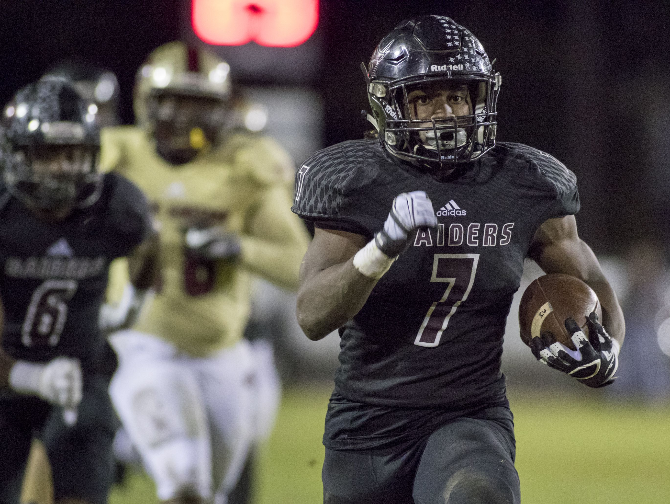Michael Carter (7) runs for a game tying touchdown during the Navarre vs. Lake Gibson high school state semifinals football game at Navarre High School on Dec. 2.