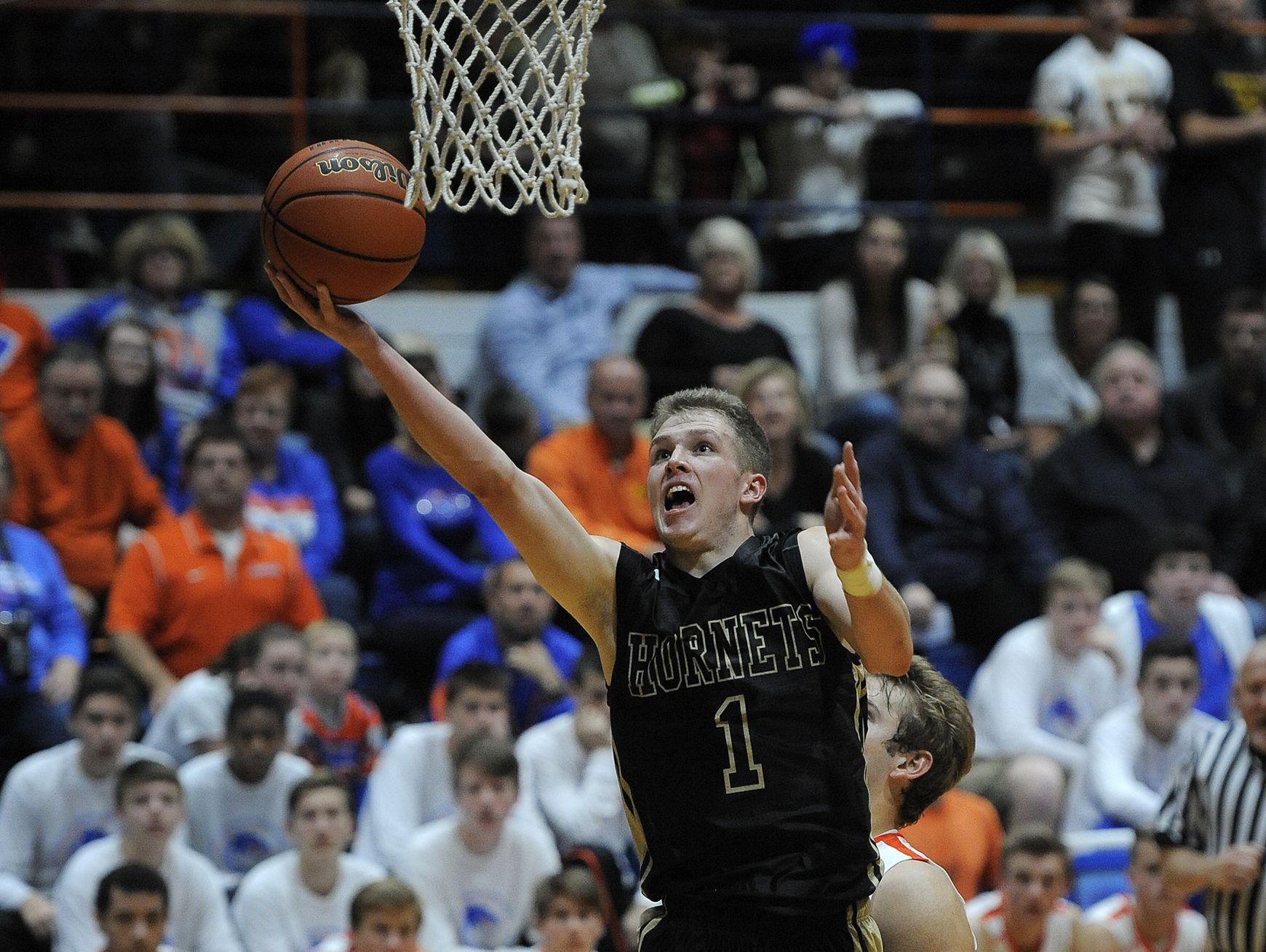 Henryville's Braxton Robertson shoots against Silver Creek?s Jacob Garrett on Nov. 22 at Silver Creek High School