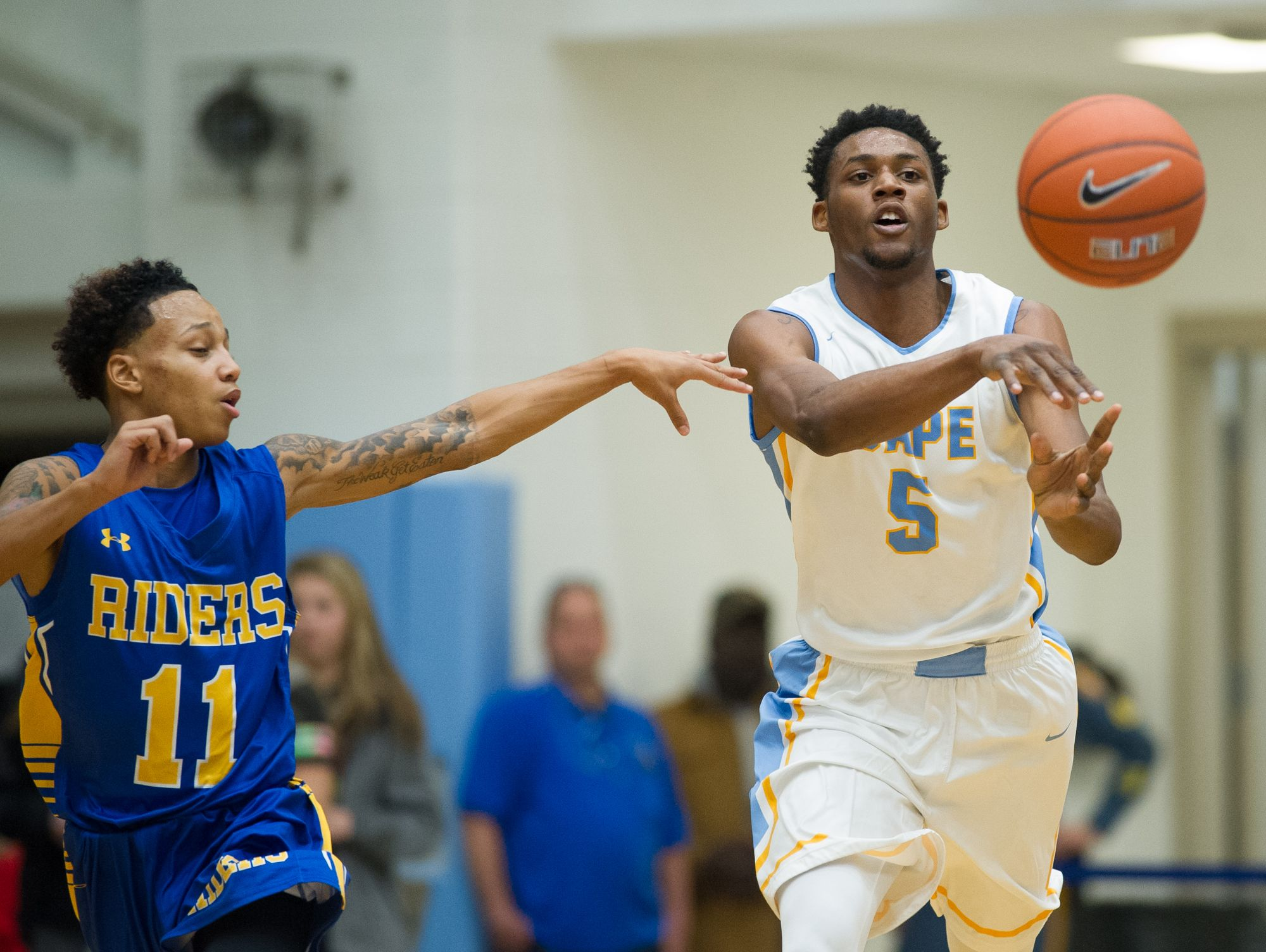 Cape Henlopen's Randy Rickards (5) passes the ball down the court in their home game against Caesar Rodney.