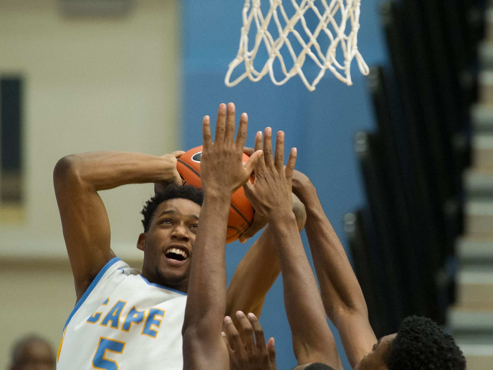 Cape Henlopen's Randy Rickards (5) goes up for a basket during their home game against Caesar Rodney.