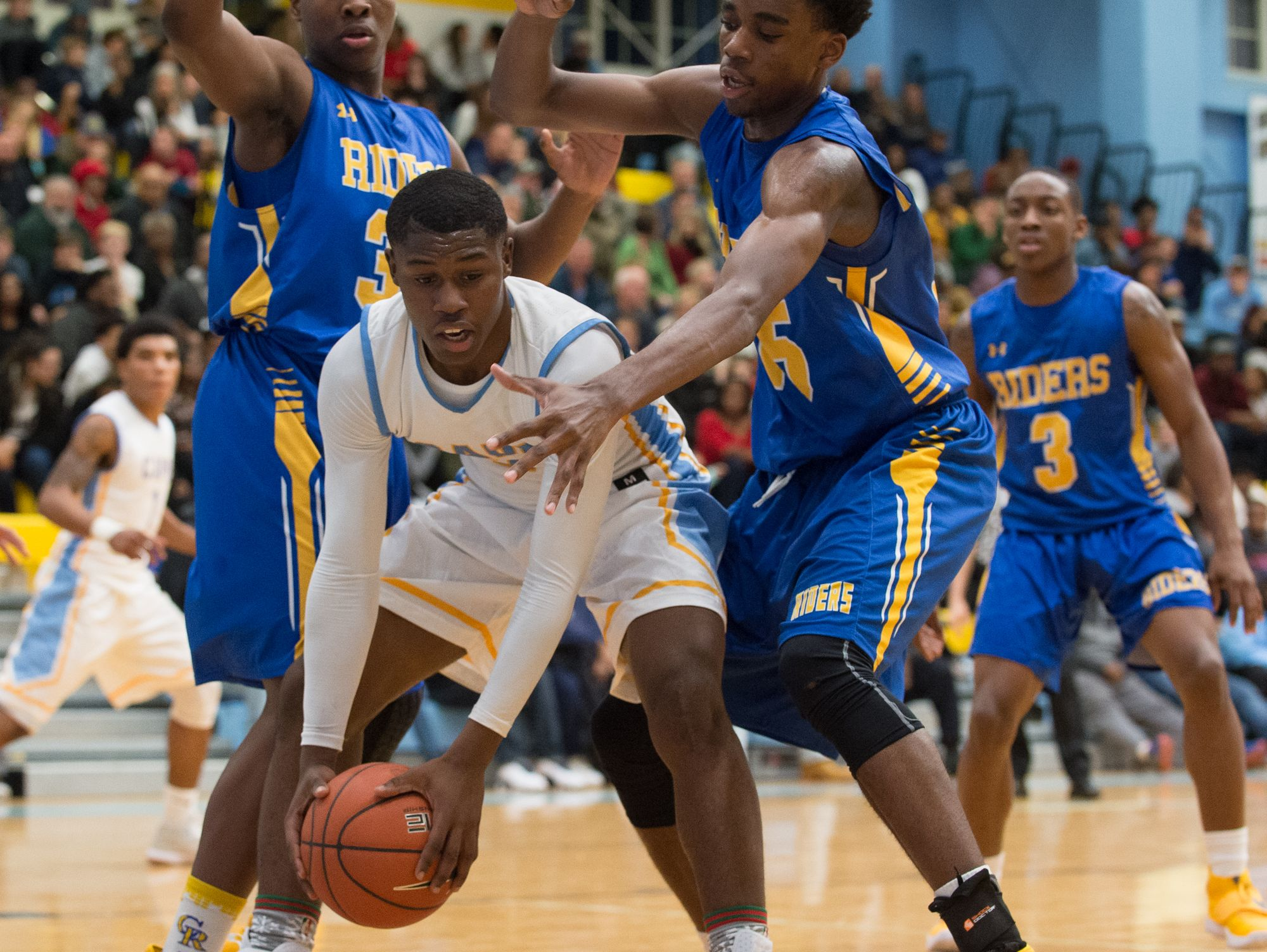 Cape Henlopen's Cory Barnes (2) being defended near the baseline in their home game against Caesar Rodney.
