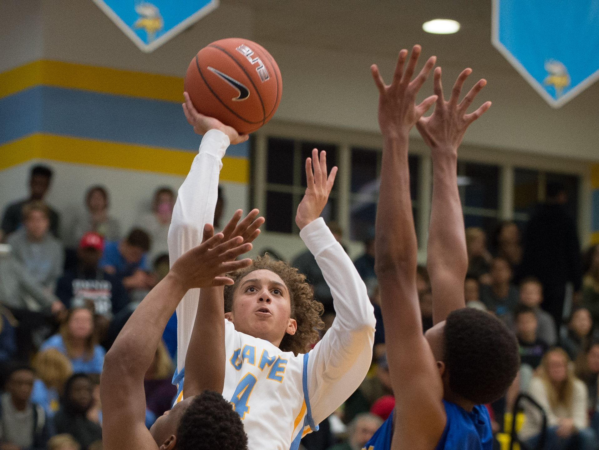 Cape Henlopen's Izaiah Dadzie (4) jumps up for a shot in their home game against Caesar Rodney.