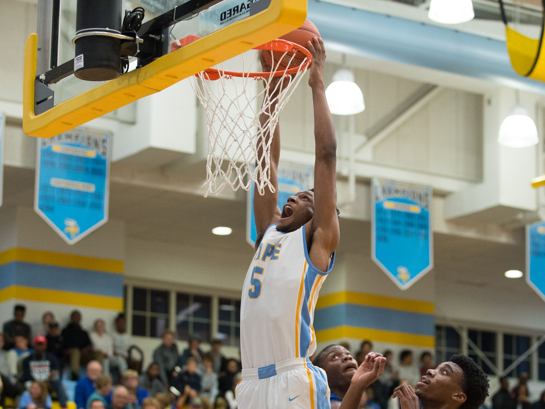 Cape Henlopen's Randy Rickards (5) goes up for a dunk in their home game against Caesar Rodney.